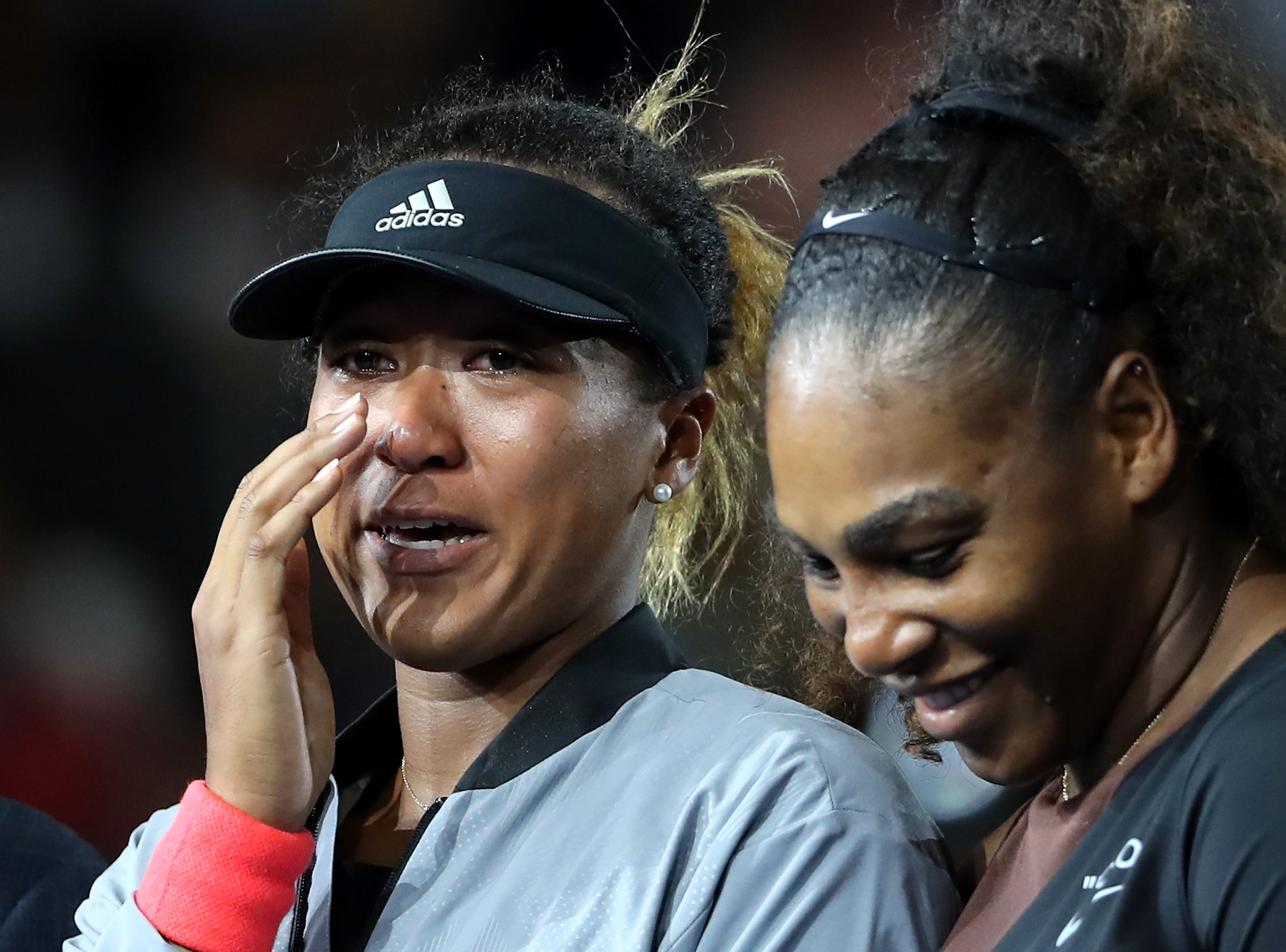 Naomi Osaka was in tears during the ceremony because the crowd was booing over the officiating controversy surrounding Serena Williams.