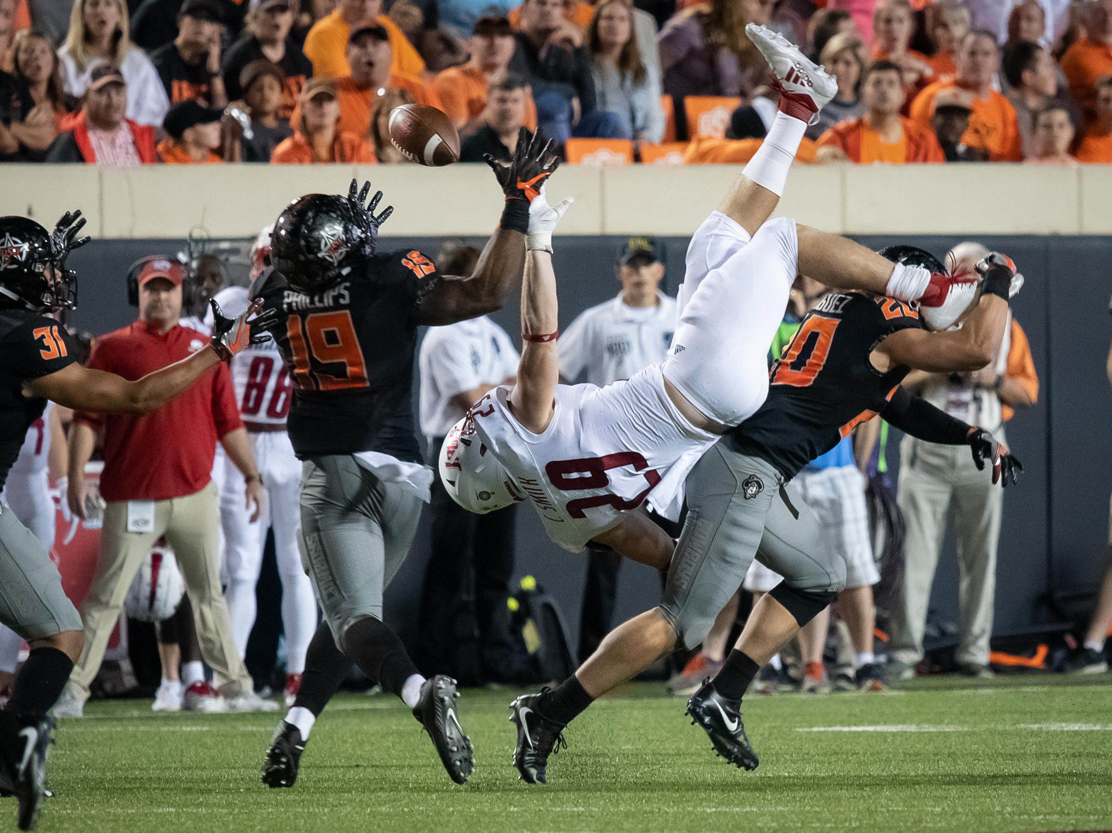 Oklahoma State Cowboys safety Malcolm Rodriguez (20) breaks up a pass intended for South Alabama Jaguars tight end Collier Smith (29) during the second half at Boone Pickens Stadium.