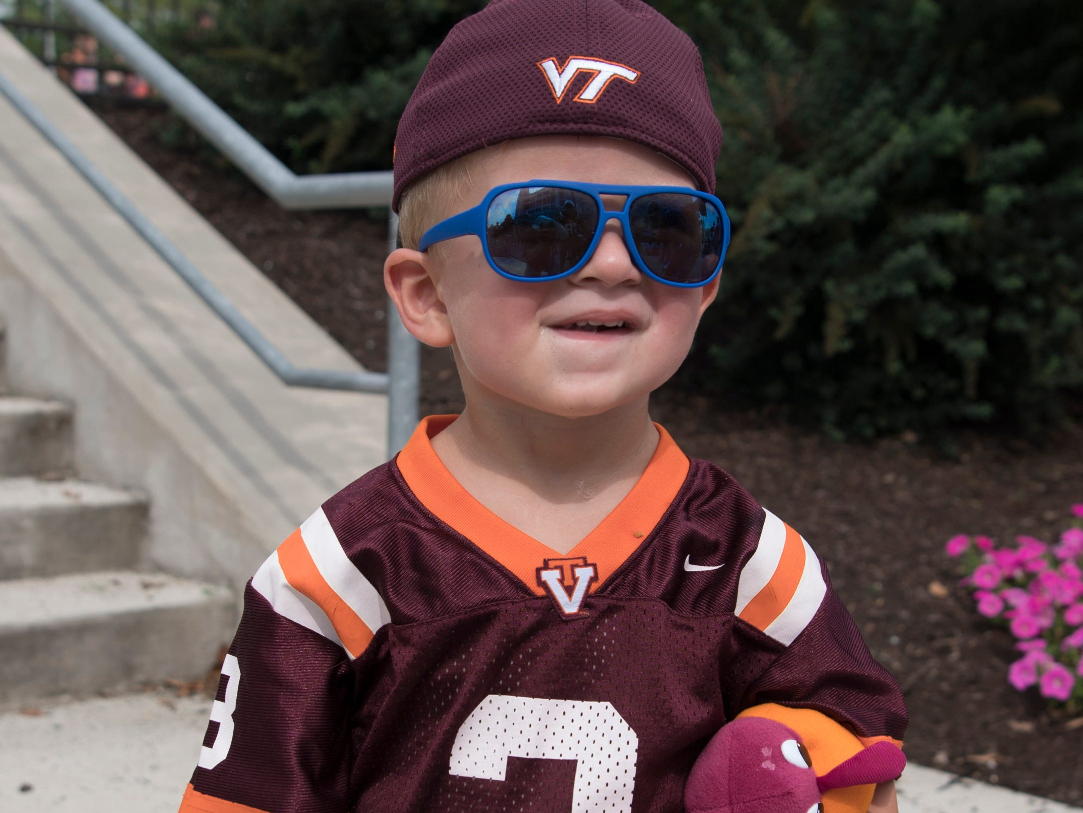 Week 2: Virginia Tech Hokies fan Brodie Price brings a stuffed Hokies football and Hokie Bird to a game against the William & Mary Tribe.