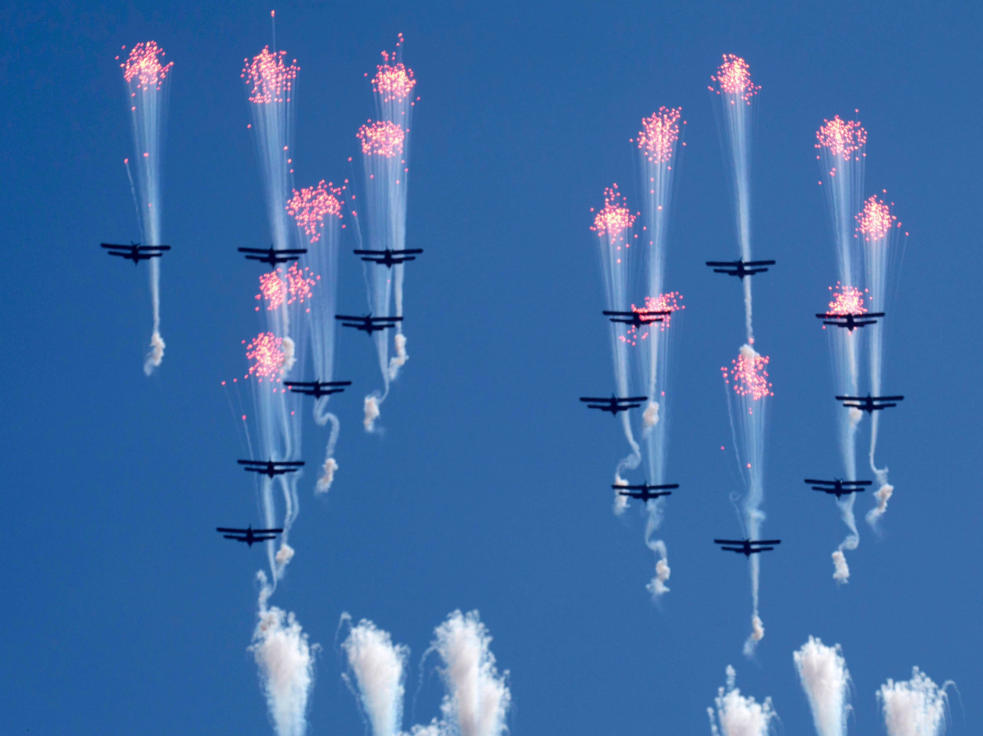 Airplanes forming the number 70 fly in formation and fire flares during a parade for the 70th anniversary of North Korea's founding day in Pyongyang, North Korea, Sunday, Sept. 9, 2018. North Korea staged a major military parade, huge rallies and will revive its iconic mass games on Sunday to mark its 70th anniversary as a nation.