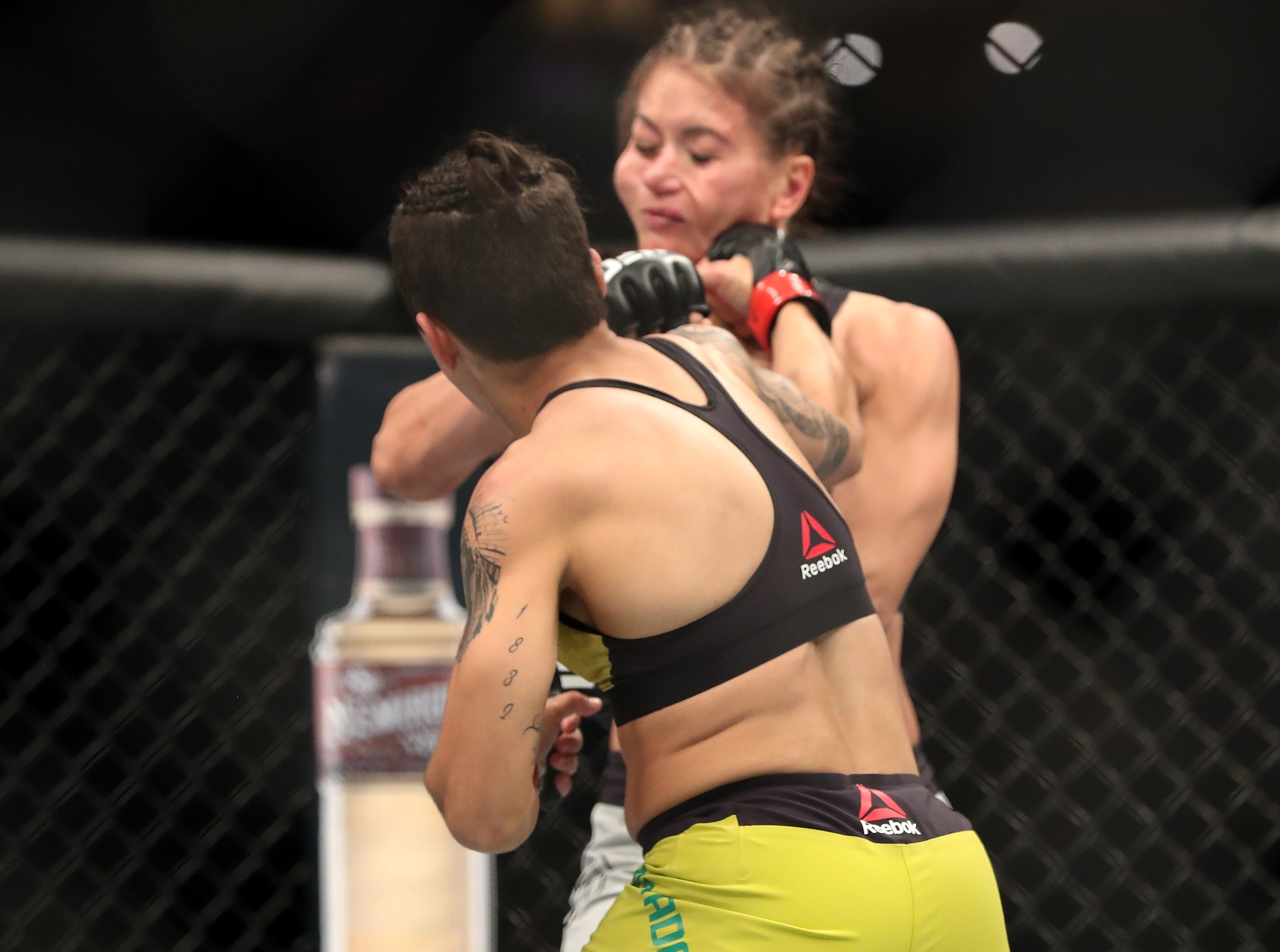 Jessica Andrade (red gloves) fights Karolina Kowalkiewicz  (blue gloves) during UFC 228 at American Airlines Center.