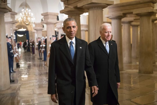 US President Barack Obama and Vice President Joe Biden walk through the Crypt of the Capitol for Donald Trump's inauguration ceremony, in Washington, DC, on January 20, 2107.