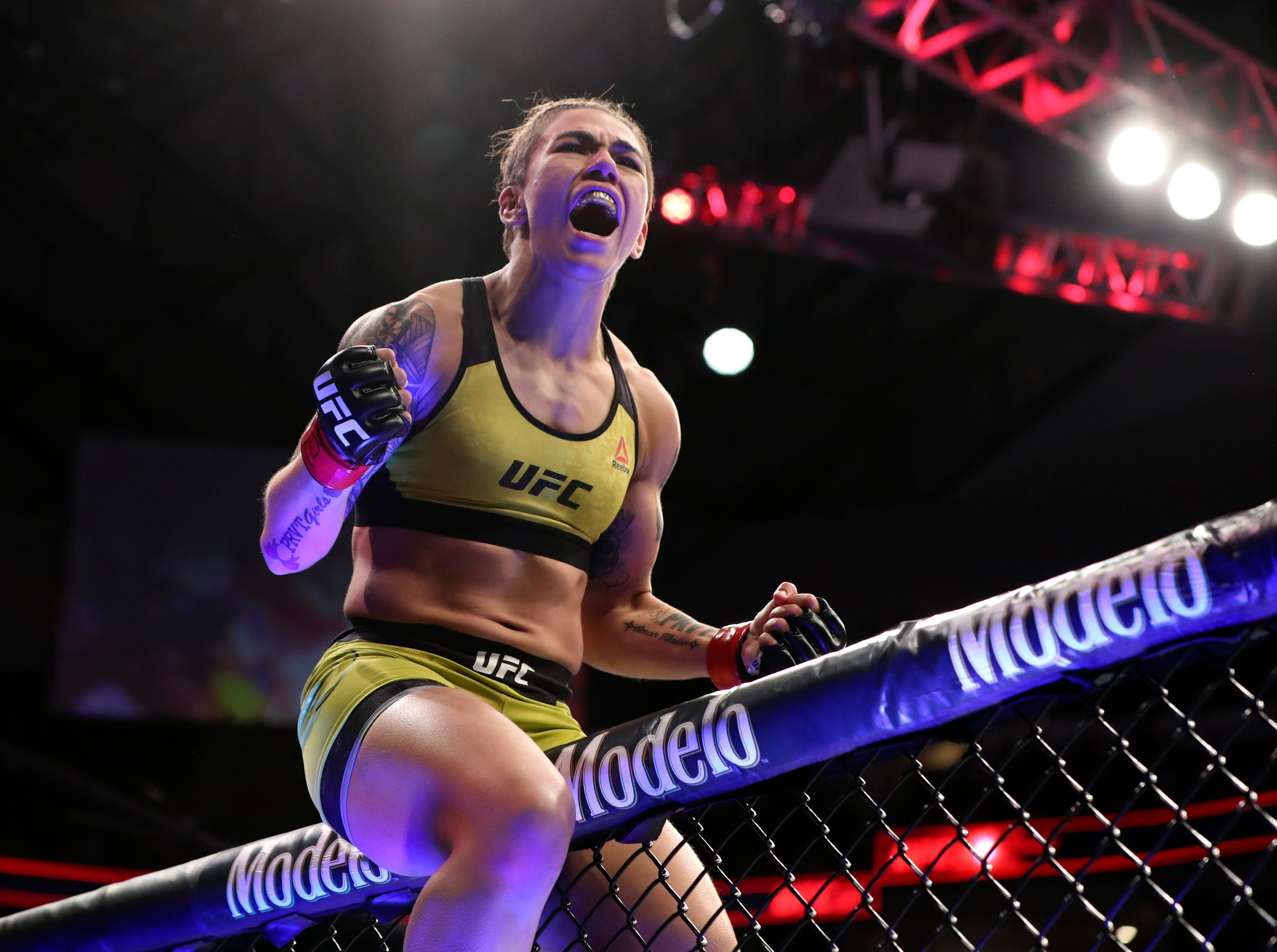 Jessica Andrade (red gloves) reacts after defeating Karolina Kowalkiewicz  (not pictured) during UFC 228 at American Airlines Center.