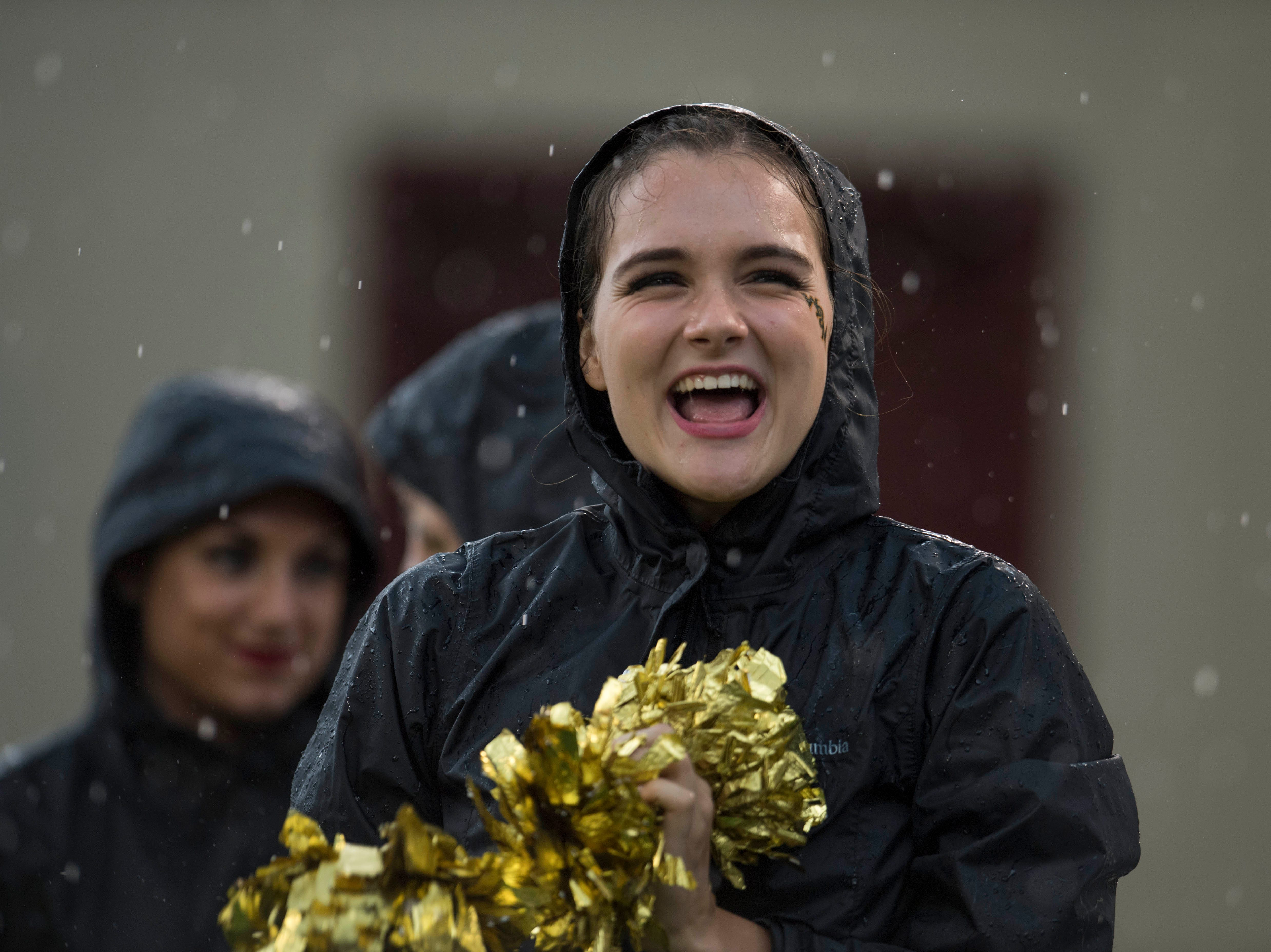Week 2: A William& Mary Tribe cheerleader performs in the rain against the Virginia Tech Hokies at Lane Stadium.