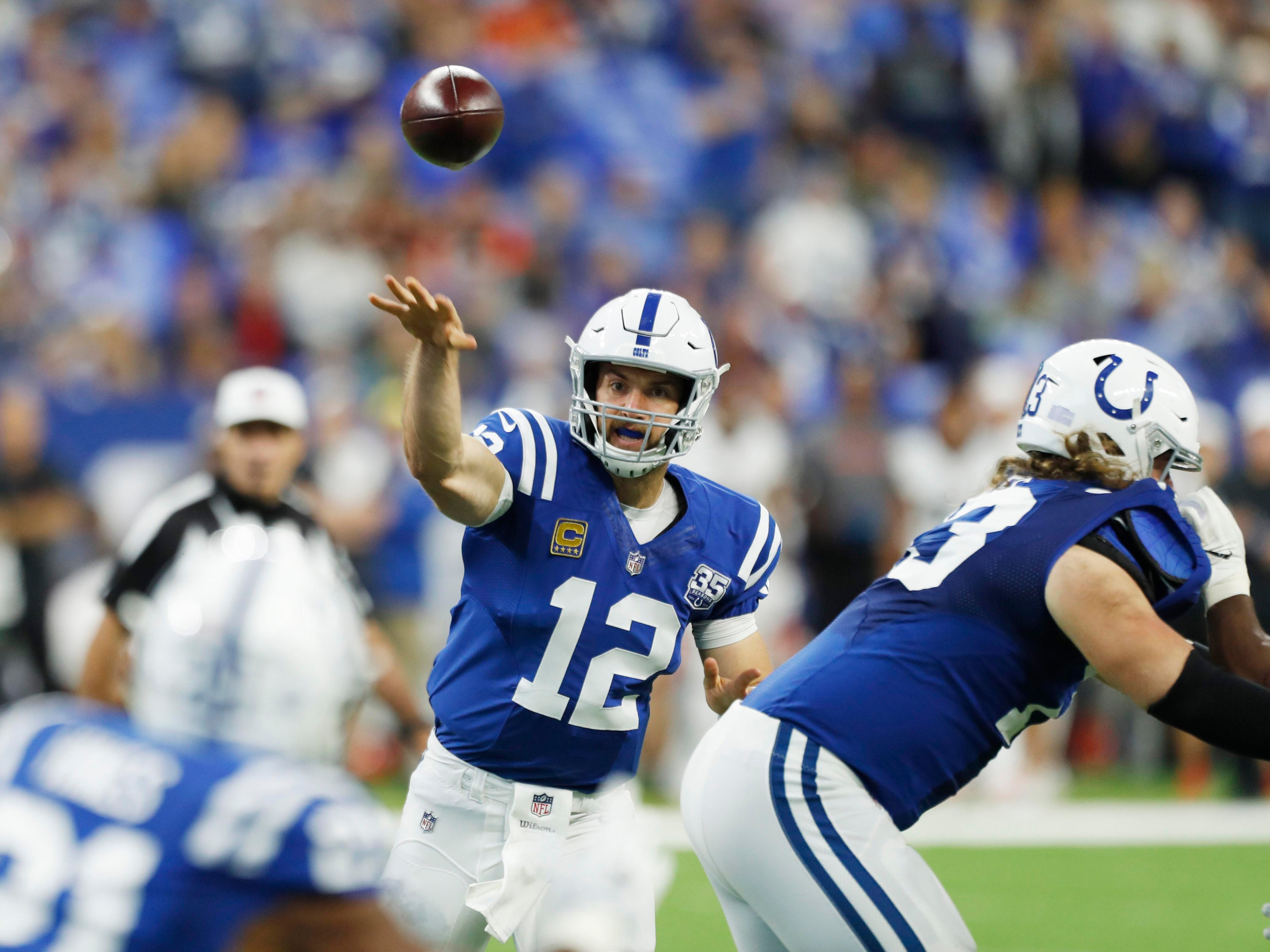 Indianapolis Colts quarterback Andrew Luck throws a pass against the Cincinnati Bengals during the first quarter at Lucas Oil Stadium.