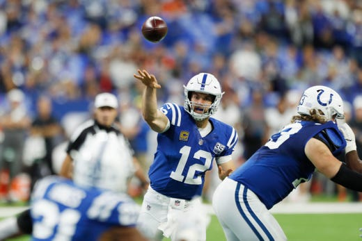 Indianapolis Colts quarterback Andrew Luck throws a pass against the Cincinnati Bengals during the first quarter at Lucas Oil Stadium. - Packers QB Carted Off In Clash With Bears