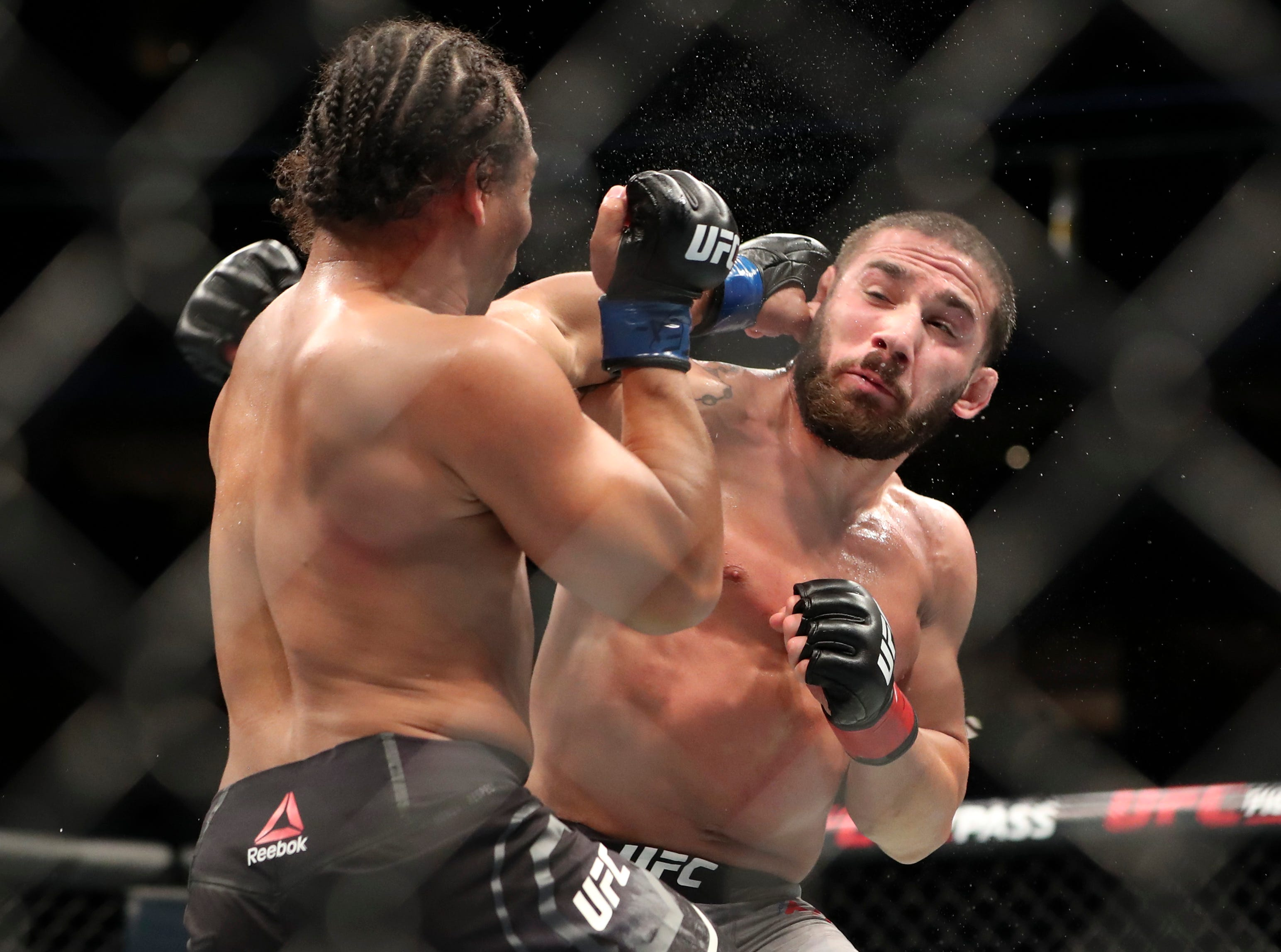 Jimmie Rivera (red gloves) fights John Dodson (blue gloves) during UFC 228 at American Airlines Center.