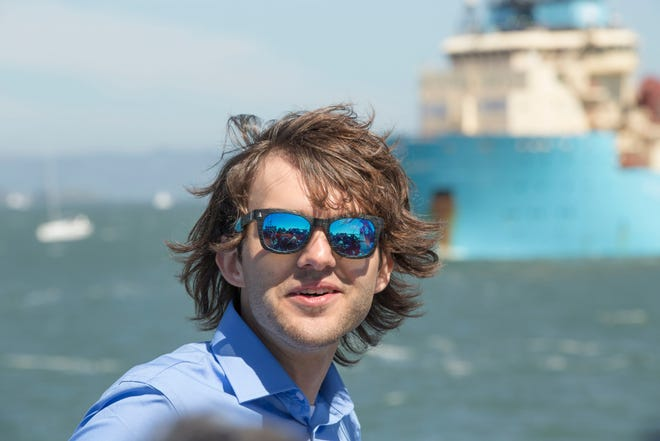 Ocean Cleanup CEO and founder Boyan Slat, 24, watches the ocean cleaning system moves through the San Francisco Bay toward the Pacific Ocean for testing on Sept. 8, 2018.