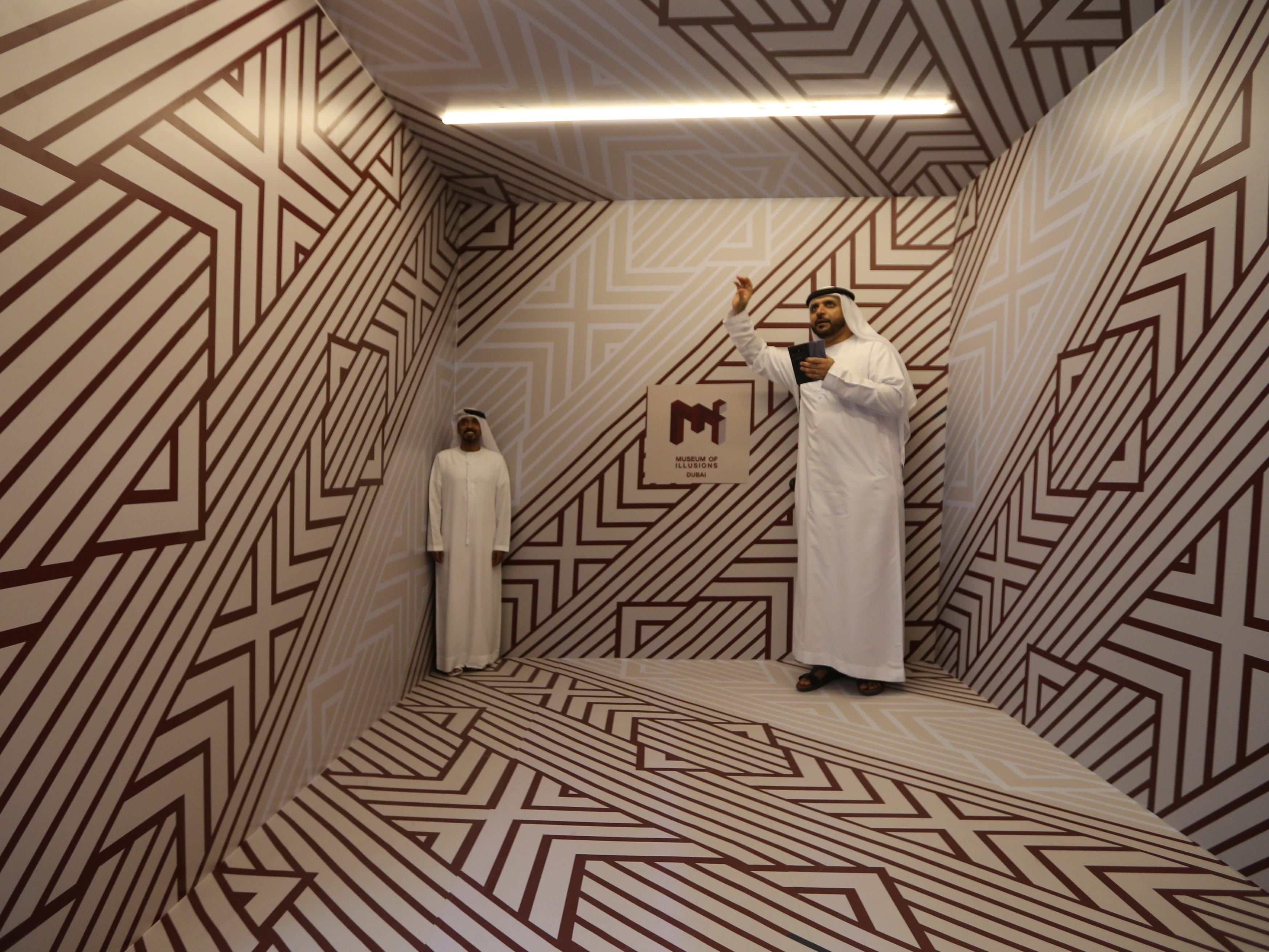 Museum visitors stand in the Ames Room at the Museum of Illusions at Al Seef near the Dubai Creek in Gulf emirate of Dubai, United Arab Emirates on Sept. 9, 2018.