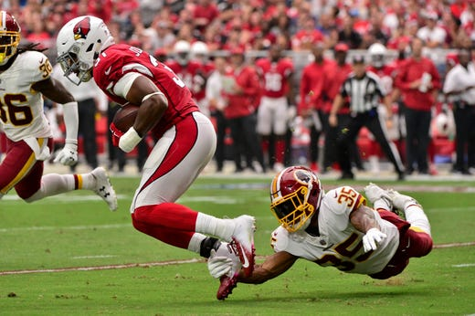 Sep 9, 2018; Glendale, AZ, USA; Washington Redskins safety Montae Nicholson (35) misses a tackle on Arizona Cardinals running back David Johnson (31) during the first half at State Farm Stadium. Mandatory Credit: Matt Kartozian-USA TODAY Sports - Packers QB Carted Off In Clash With Bears