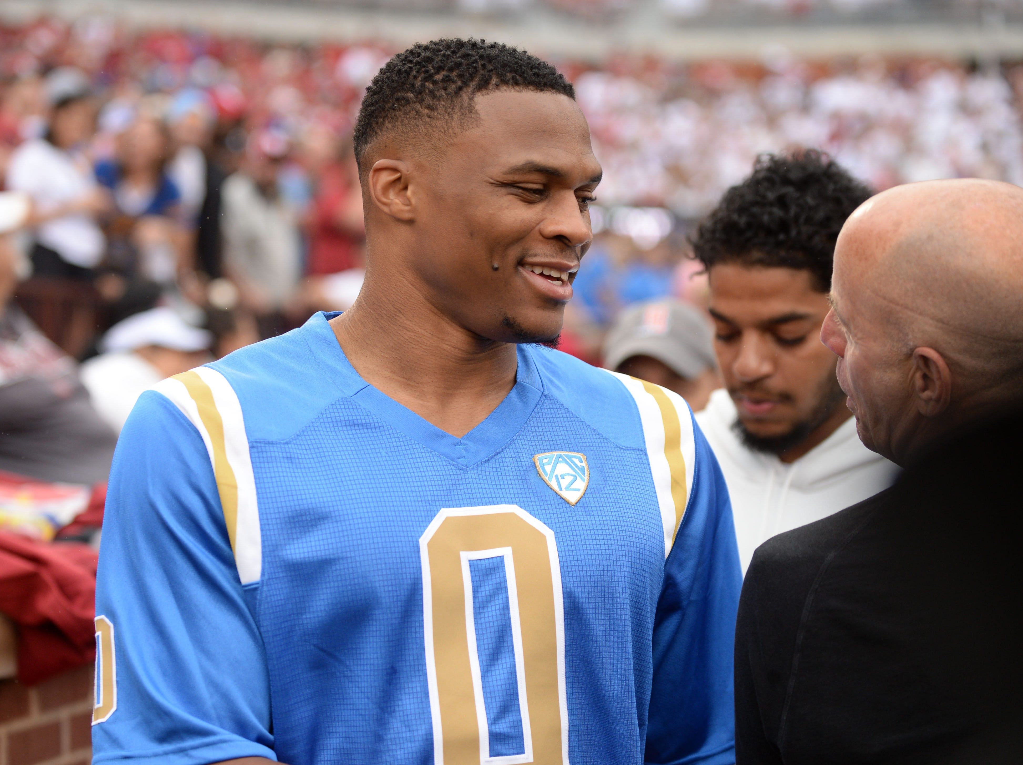 Week 2: Oklahoma City Thunder player Russell Westbrook is seen on the sideline during a game between the Oklahoma Sooners and the UCLA Bruins.