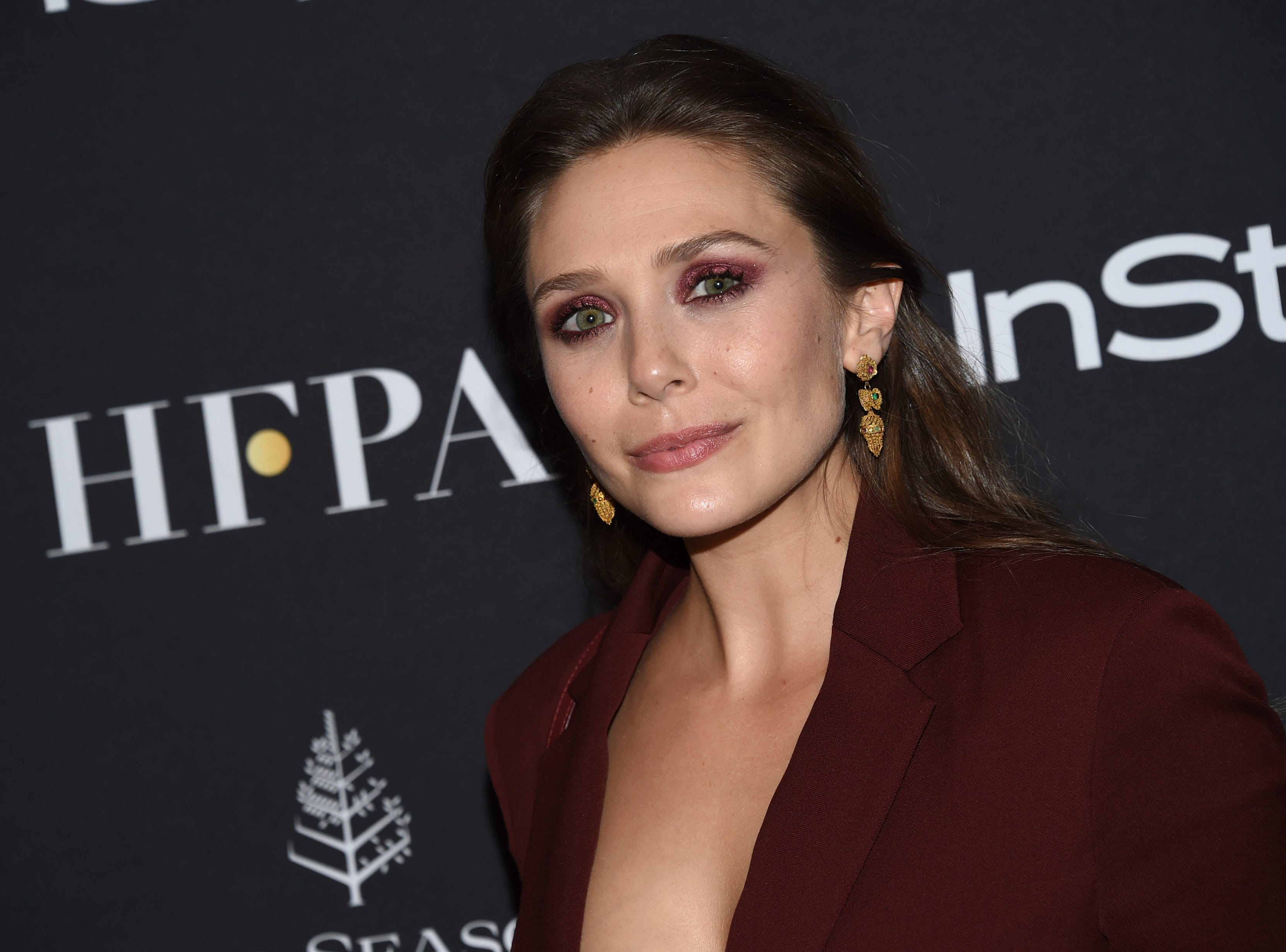 Actress Elizabeth Olsen attends the Hollywood Foreign Press Association/InStyle party on Day 3 of the Toronto International Film Festival at the Four Seasons Hotel Toronto on Saturday, Sept. 8, 2018, in Toronto. (Photo by Evan Agostini/Invision/AP) ORG XMIT: TOEA213