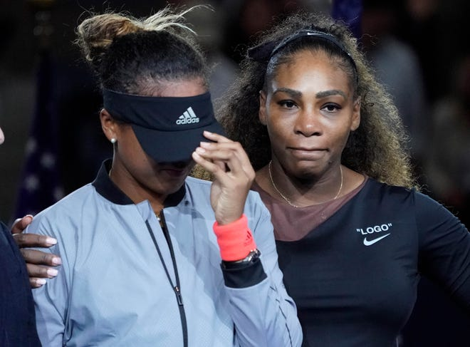 Naomi Osaka cries as Serena Williams comforts her after the crowd booed during the trophy ceremony following the US Open women's final.