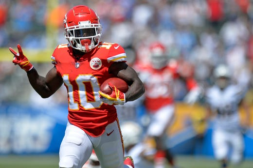 Sep 9, 2018; Carson, CA, USA; Kansas City Chiefs wide receiver Tyreek Hill (10) returns a punt for a touchdown during the first quarter against the Los Angeles Chargers at StubHub Center. Mandatory Credit: Jake Roth-USA TODAY Sports - Packers QB Carted Off In Clash With Bears