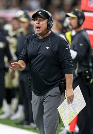 New Orleans Saints head coach Sean Payton talks to an official in the second half against the Tampa Bay Buccaneers at the Mercedes-Benz Superdome.