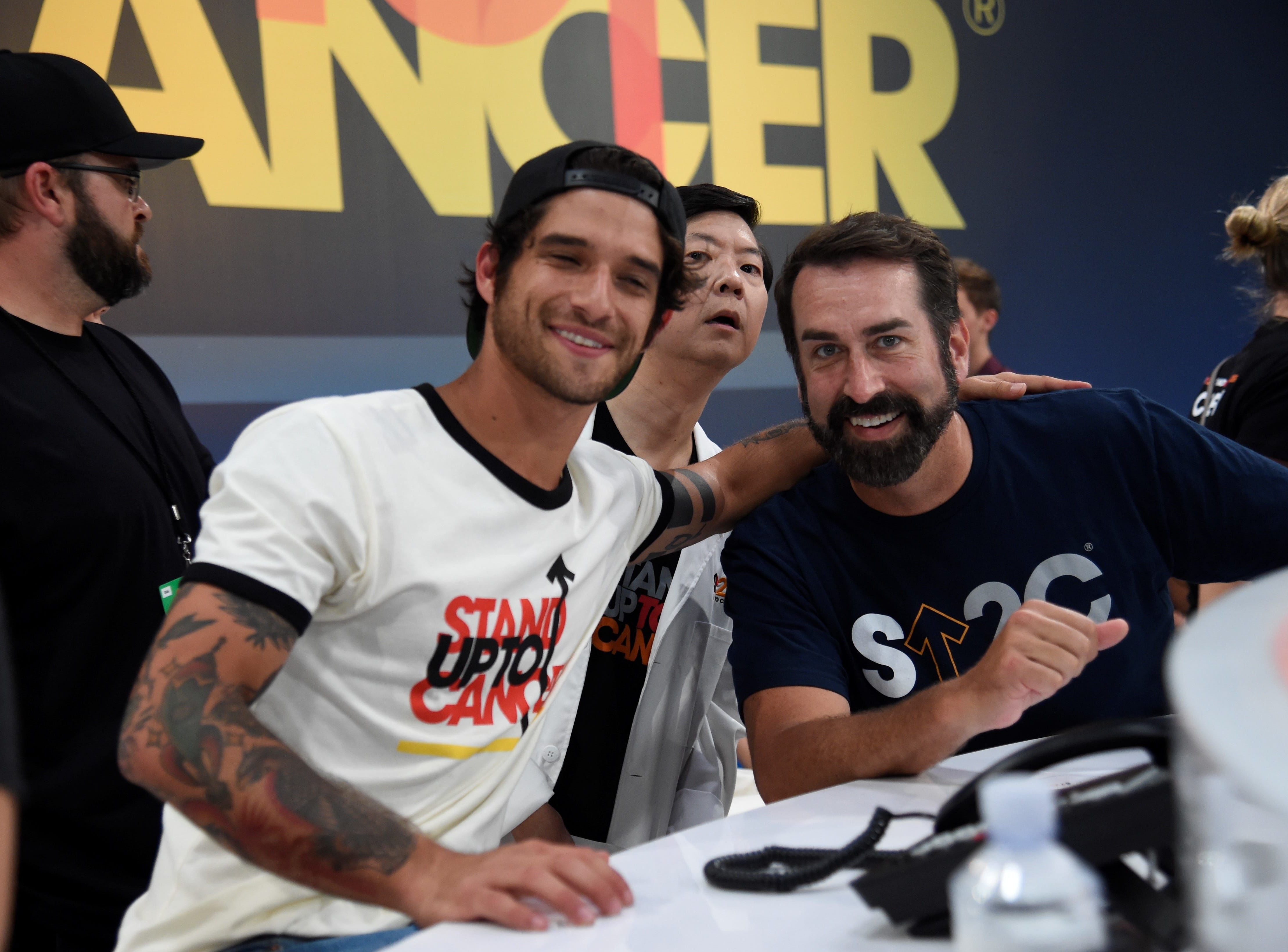 "(L-R) Tyler Posey, Ken Jeong and Rob Riggle at the phone banks for ""Stand Up To Cancer."""