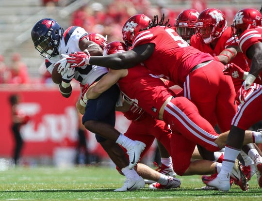 Arizona running back Darrius Smith is tackled on a run during the fourth quarter against the Houston.