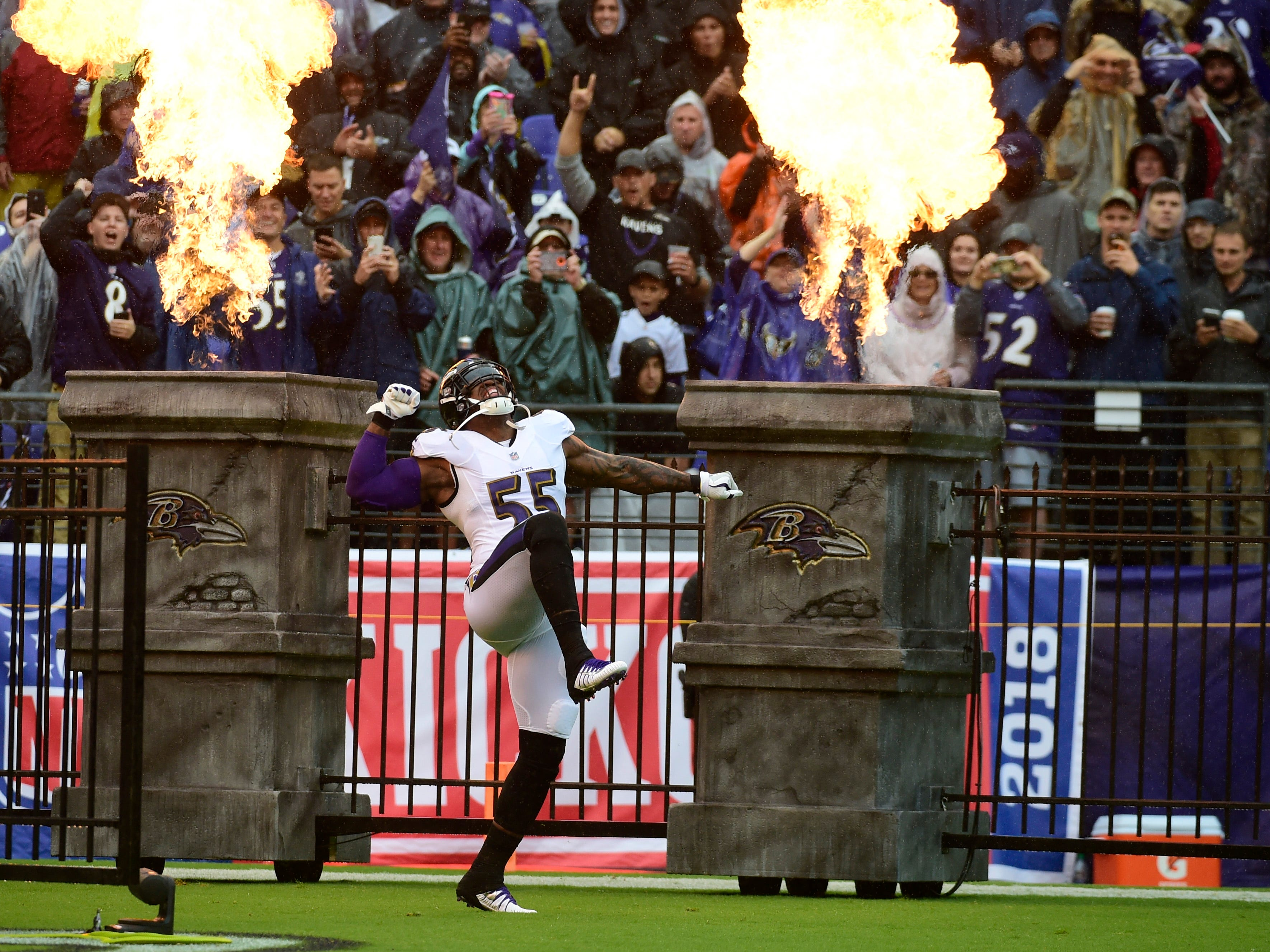 Baltimore Ravens linebacker Terrell Suggs enters the field before the game against the Buffalo Bills at M&T Bank Stadium.