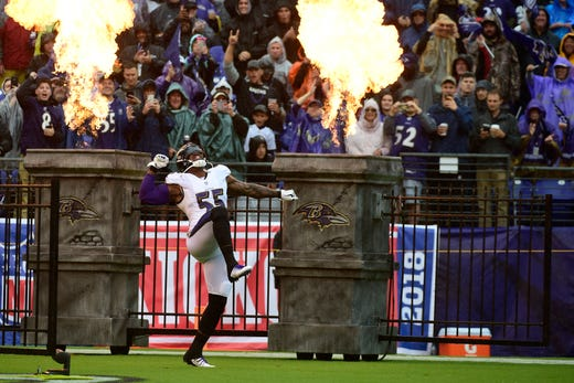 Baltimore Ravens linebacker Terrell Suggs enters the field before the game against the Buffalo Bills at M&T Bank Stadium. - Packers QB Carted Off In Clash With Bears