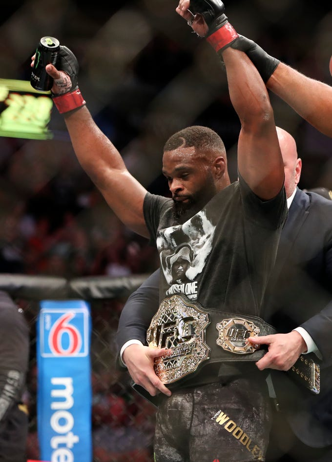 Tyron Woodley (red gloves) receives his championship belt after the fight against Darren Till (not pictured) during UFC 228 at American Airlines Center.