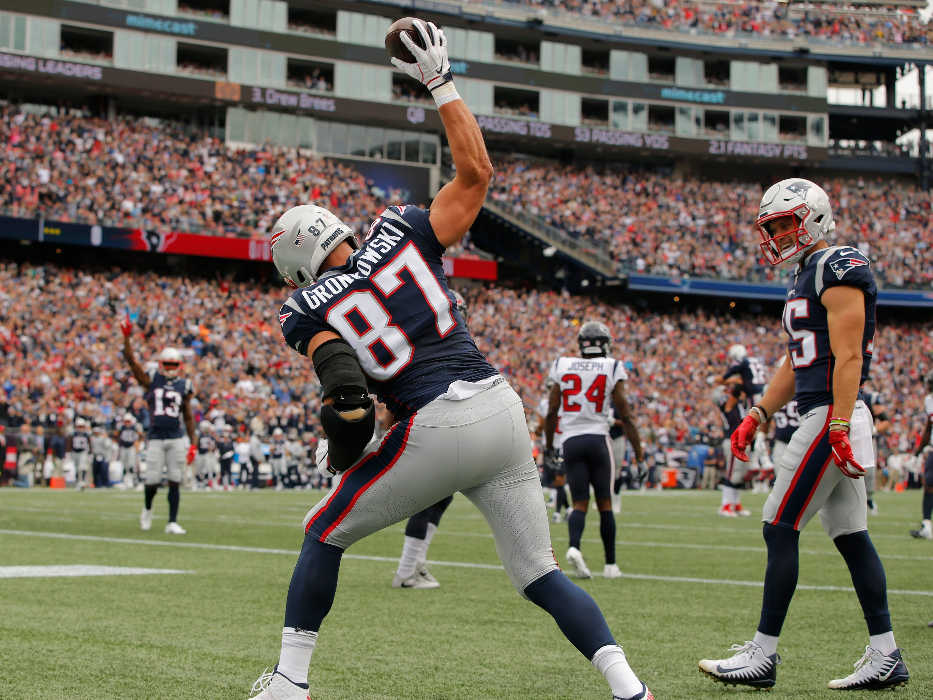 New England Patriots tight end Rob Gronkowski reacts after his touchdown against the Houston Texans in the first quarter at Gillette Stadium.