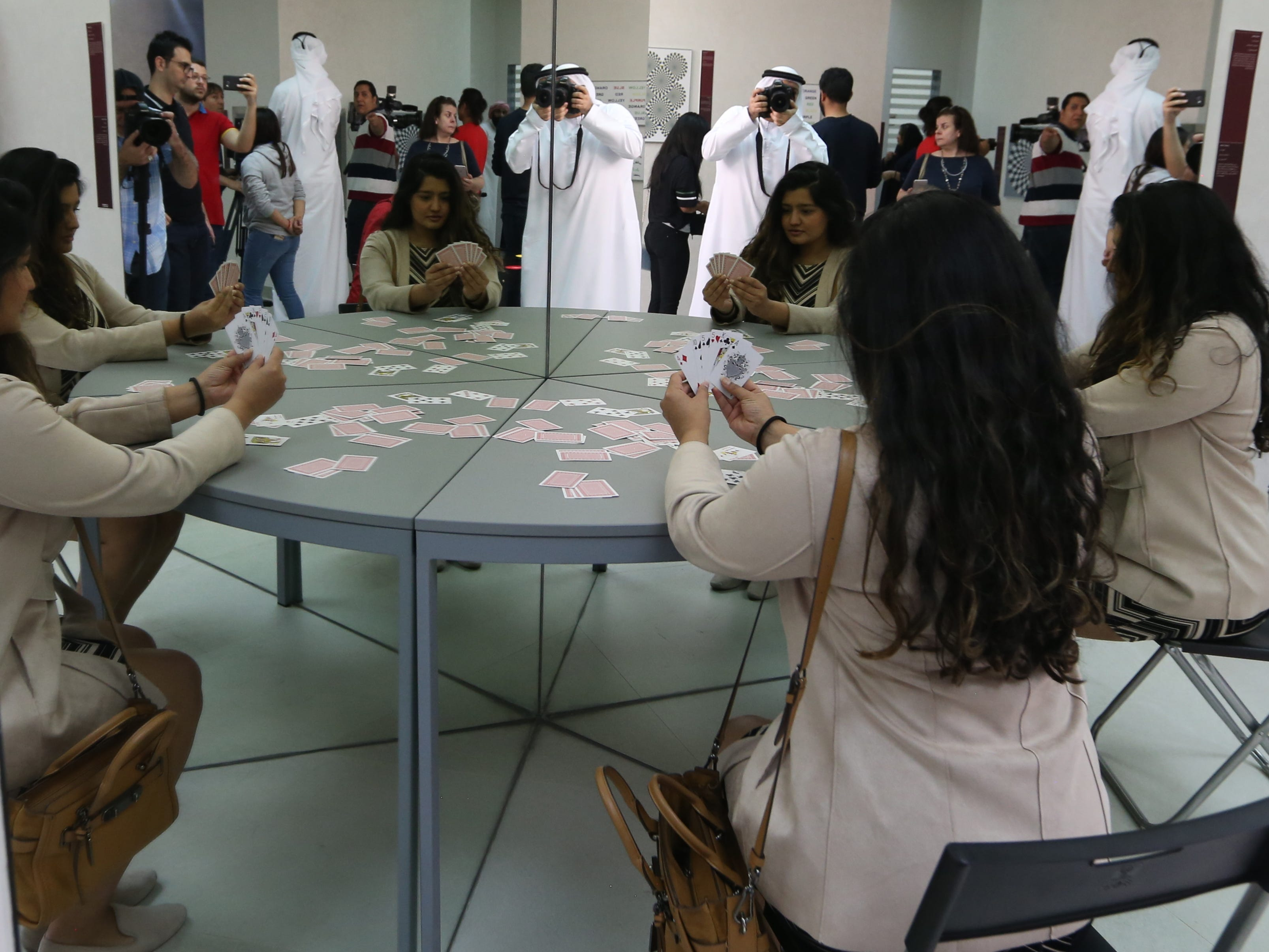 People inspect the cloning table displayed at the Museum of Illusions at Al Seef near the Dubai Creek in Gulf emirate of Dubai, United Arab Emirates on  Sept. 9, 2018.