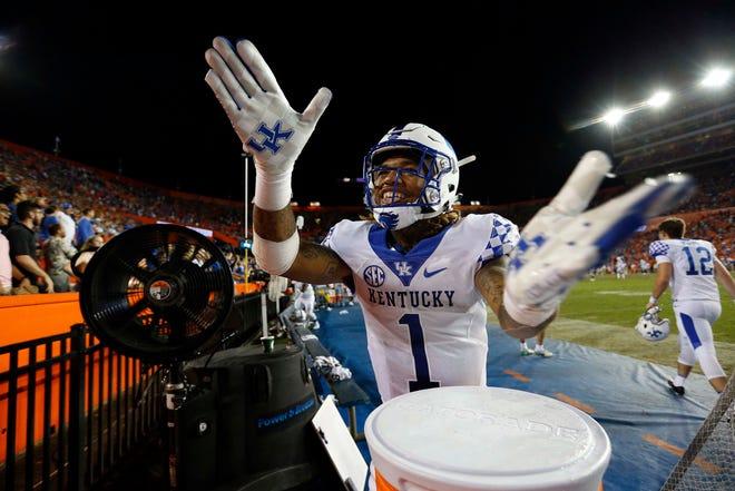 Kentucky Wildcats wide receiver Lynn Bowden Jr. (1) does the Gator Chomp after beating Florida.