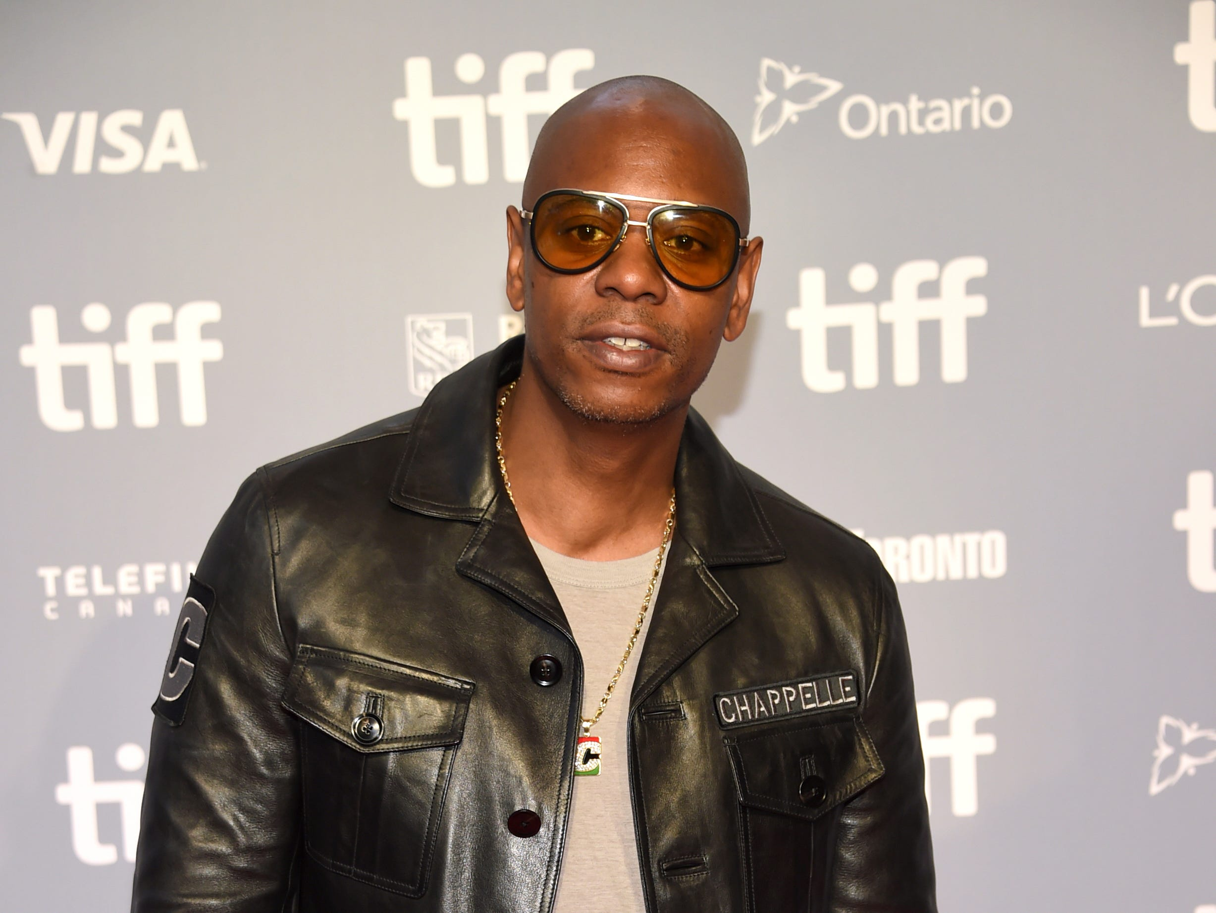 "Dave Chappelle attends the press conference for ""A Star Is Born"" on day 4 of the Toronto International Film Festival at the TIFF Bell Lightbox on Sunday, Sept. 9, 2018, in Toronto. (Photo by Evan Agostini/Invision/AP) ORG XMIT: CANPM106"