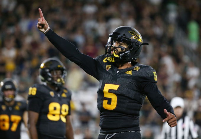 Arizona State quarterback Manny Wilkins reacts as the Sun Devils prepare to kick the game-winning field goal against Michigan State.