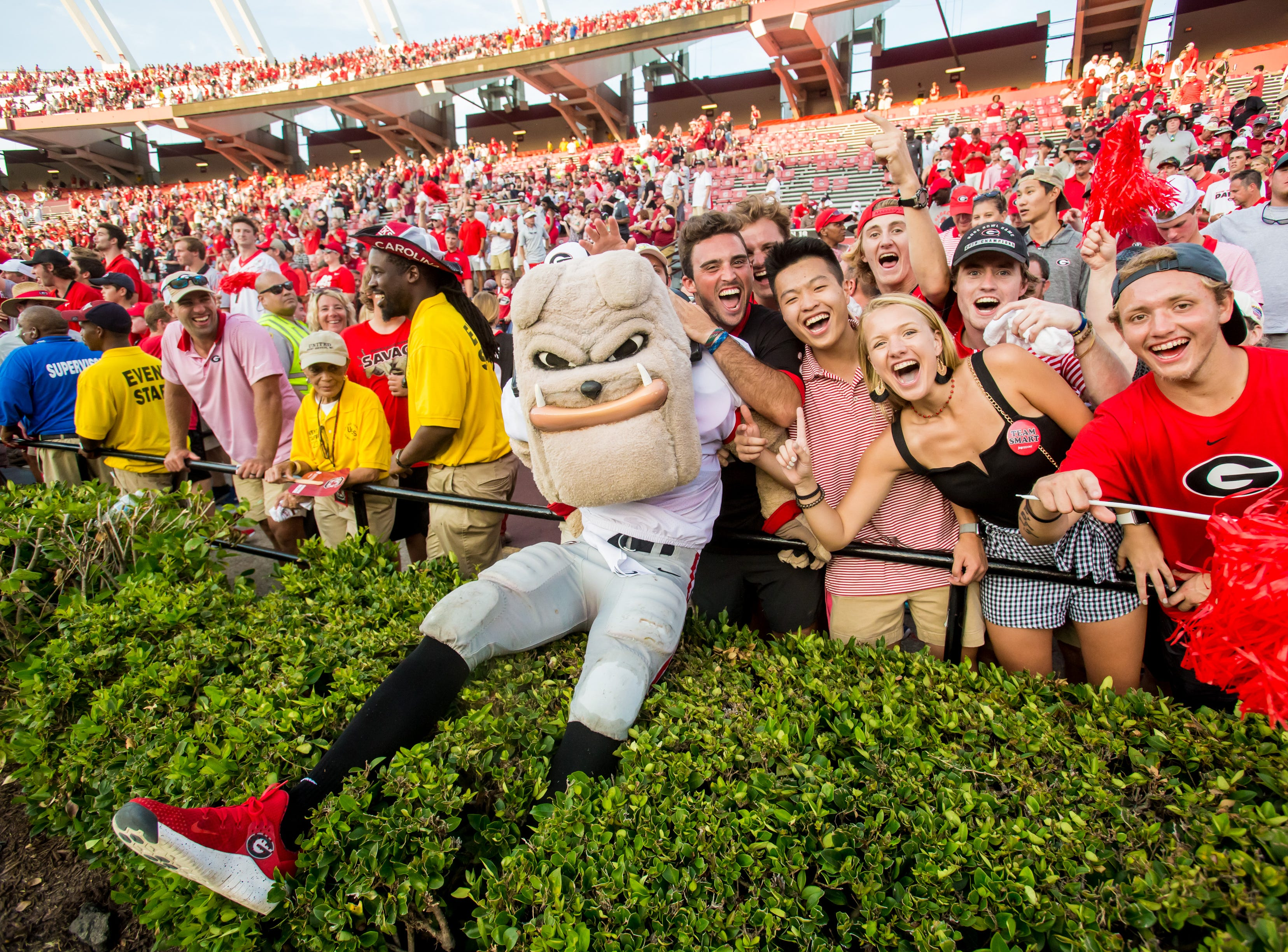 Week 2: Georgia Bulldogs fans celebrate with mascot Harry Dawg following the win over the South Carolina Gamecocks at Williams-Brice Stadium.