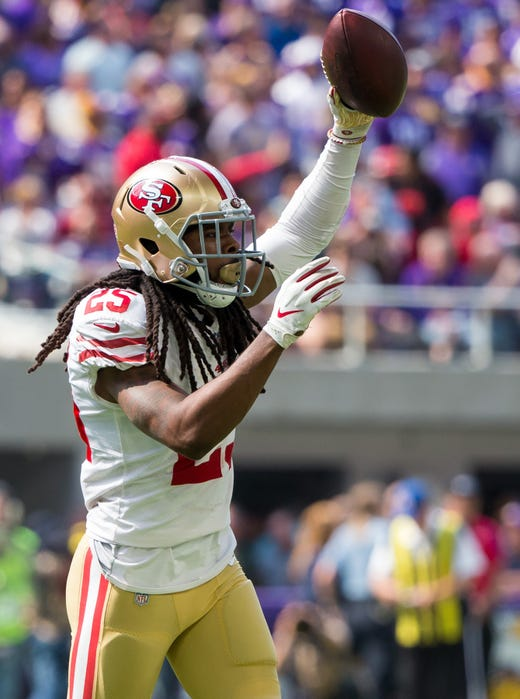 San Francisco 49ers defensive back Richard Sherman recovers a fumble in the second quarter against Minnesota Vikings at U.S. Bank Stadium. - Packers QB Carted Off In Clash With Bears
