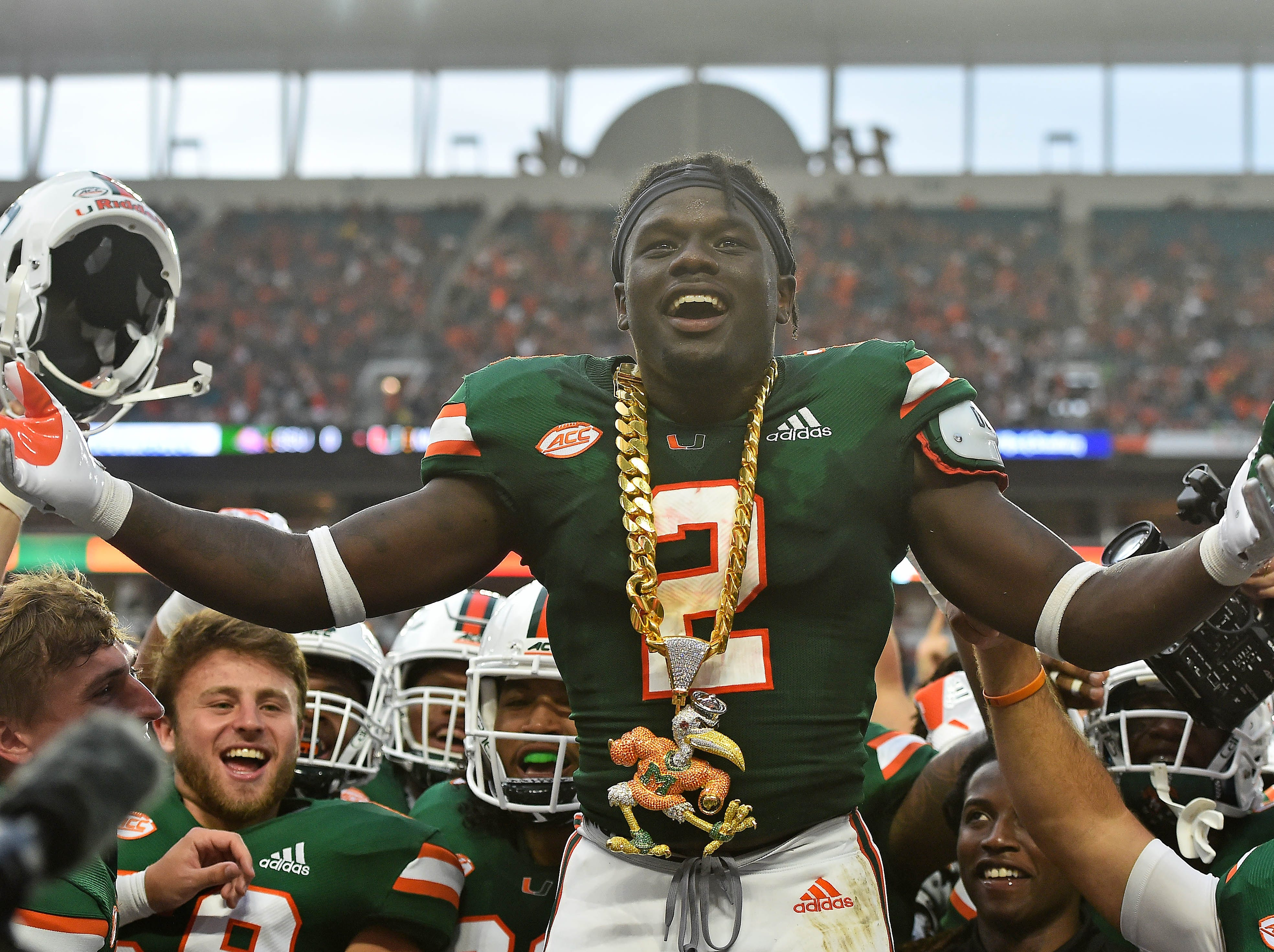 Miami Hurricanes defensive back Trajan Bandy (2) celebrates with the turnover chain after recovering a fumble by Savannah State Tigers during the first half at Hard Rock Stadium.
