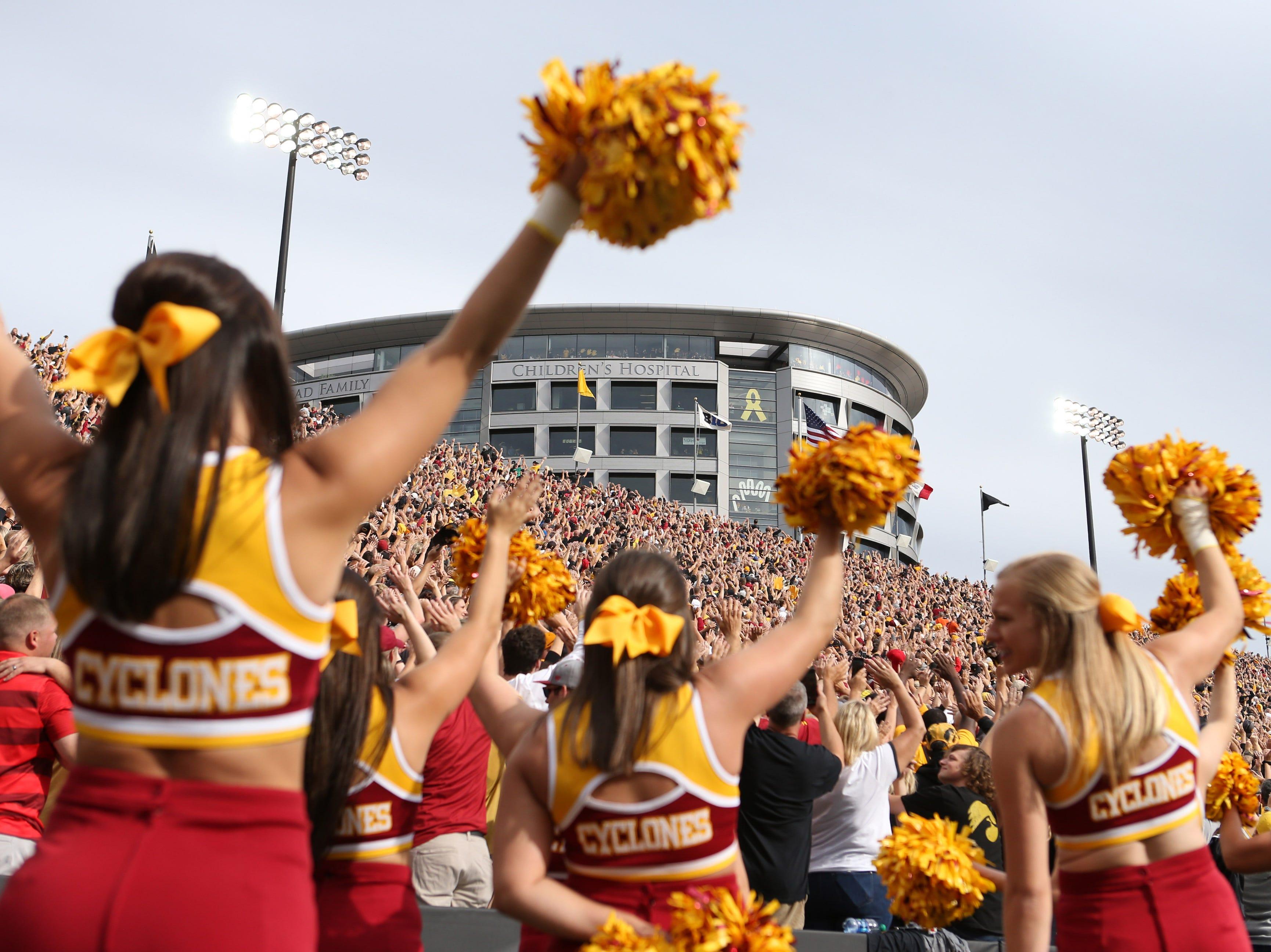 Week 2: Iowa State Cyclones cheerleaders take part in the Iowa Wave to the Iowa Children's Hospital.