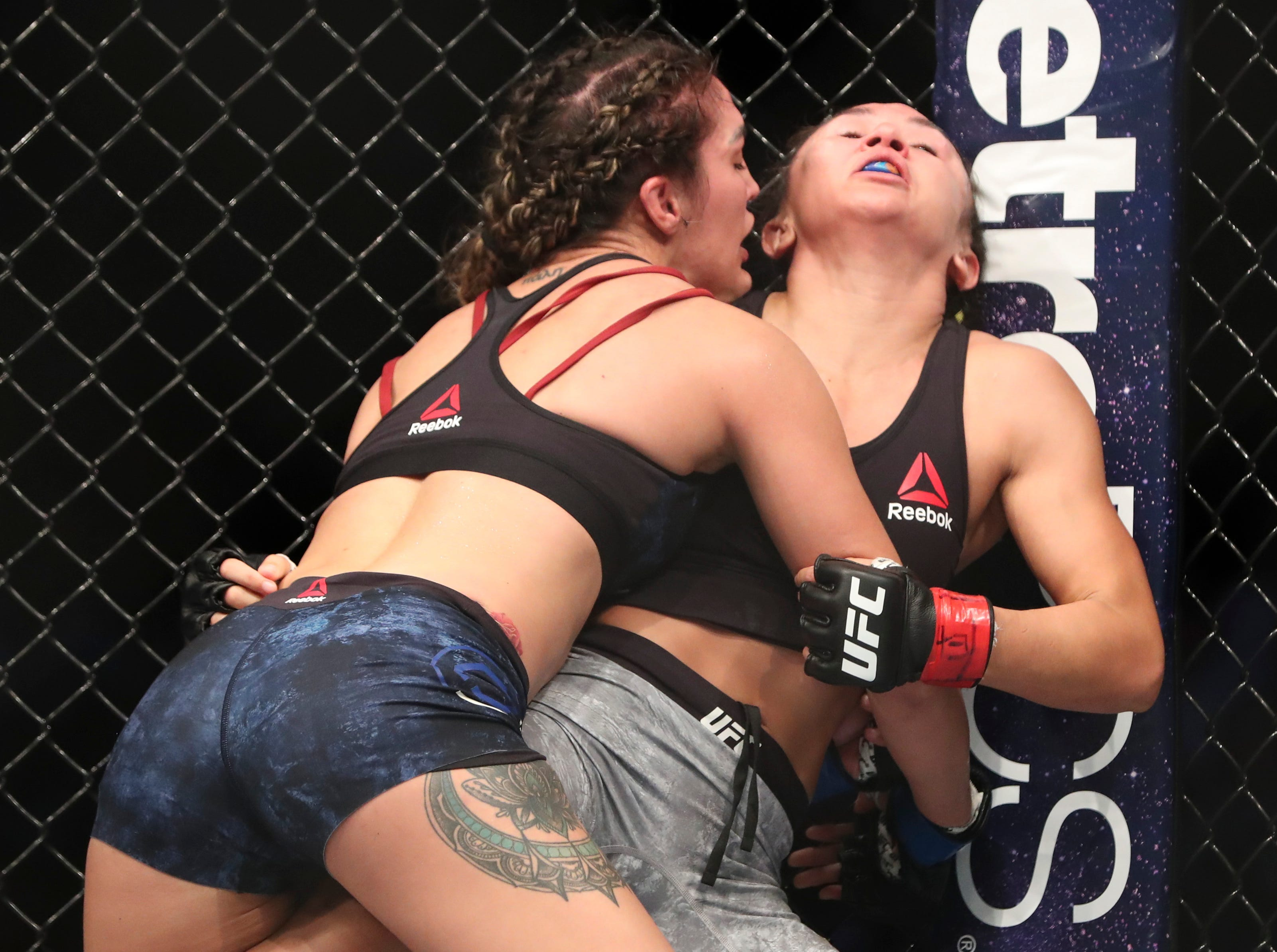 Carla Esparza (red gloves) fights Tatiana Suarez (blue gloves) during UFC 228 at American Airlines Center.