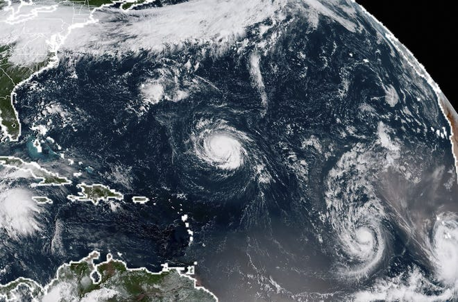 This satellite image taken Sunday shows (from left) Tropical Storm Florence, Tropical Storm Isaac and Tropical Storm Helene in the Atlantic Ocean.
