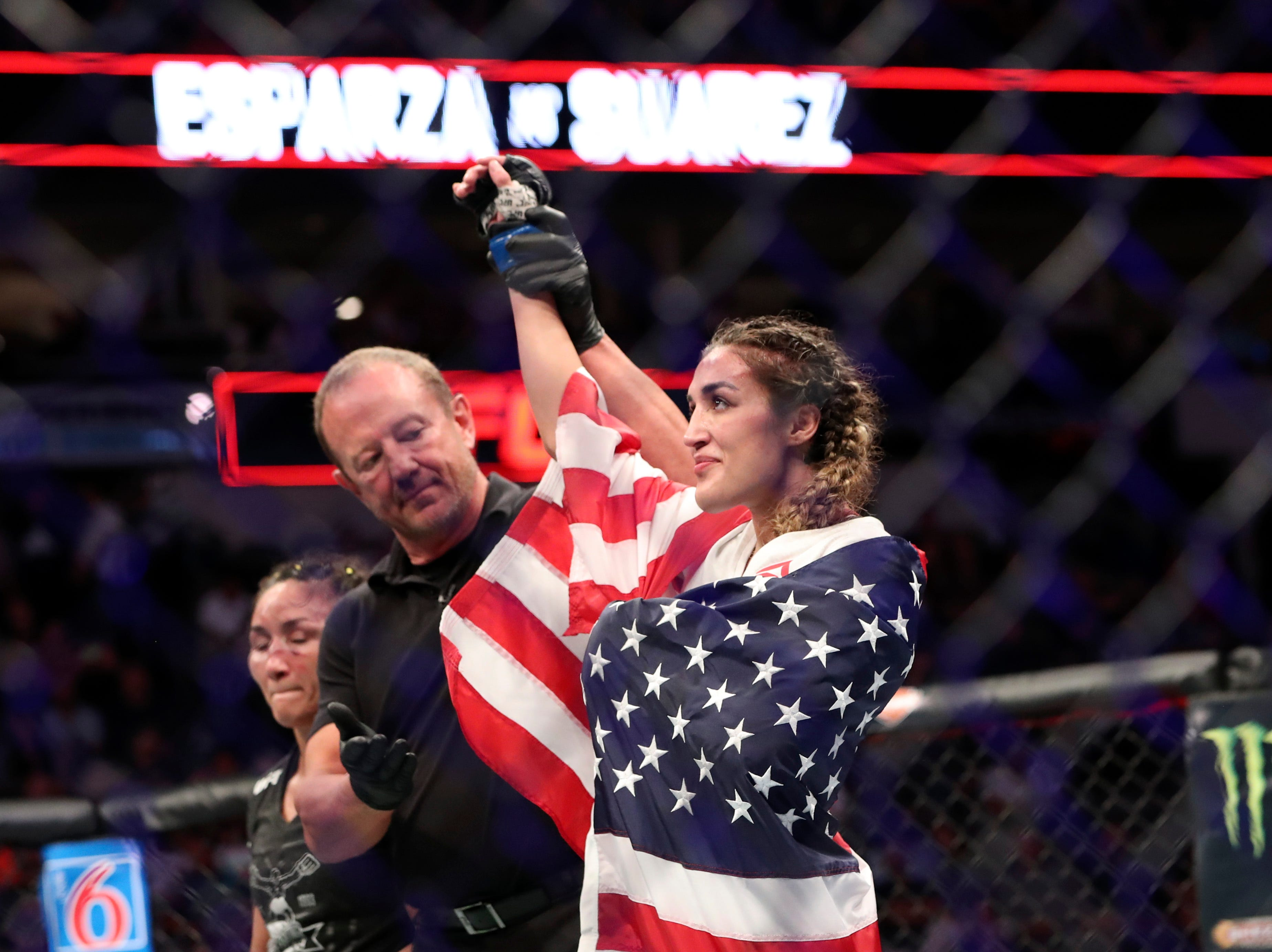 Tatiana Suarez (blue gloves) reacts after defeating Carla Esparza (not pictured) during UFC 228 at American Airlines Center.