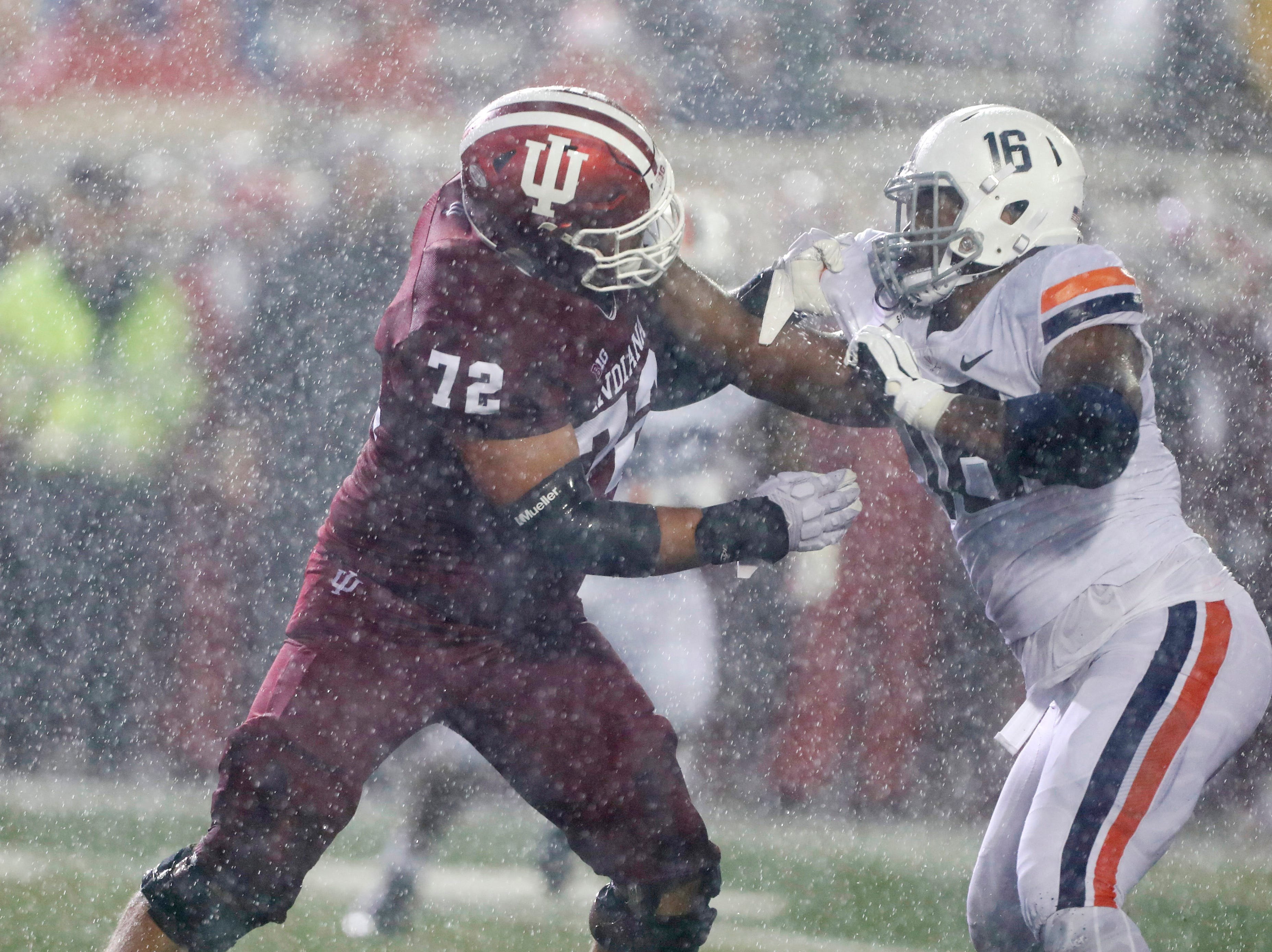 Indiana Hoosiers offensive lineman Simon Stepaniak (72) blocks Virginia Cavaliers defensive end Richard Burney (16) during the first quarter at Memorial Stadium.