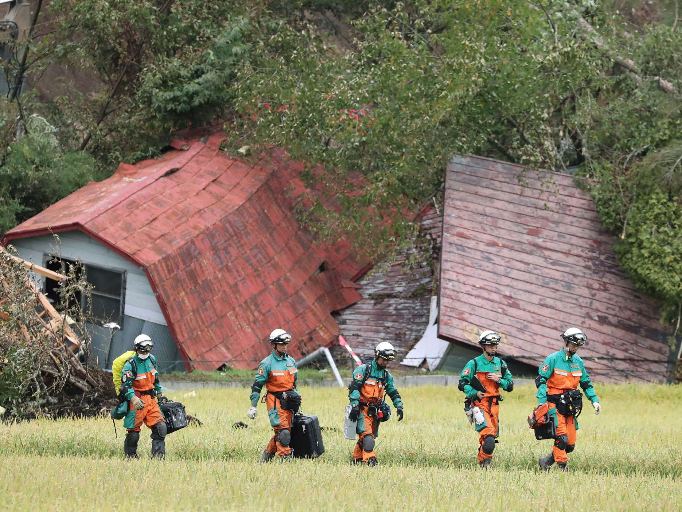 Rescue teams from Tokyo Police search for missing people in Astuma on Sept. 9, 2018 after a 6.6-magnitude earthquake hit the northern Japanese island of Hokkaido on September 6.