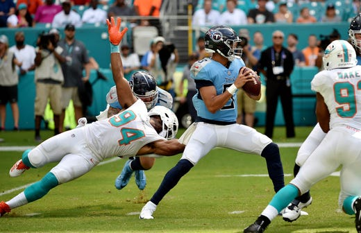 Sep 9, 2018; Miami Gardens, FL, USA; Tennessee Titans quarterback Marcus Mariota (8) throws a pass as Miami Dolphins defensive end Robert Quinn (94) has his facemask pulled on by Tennessee Titans offensive tackle Taylor Lewan (77) during the first half at Hard Rock Stadium. Mandatory Credit: Steve Mitchell-USA TODAY Sports - Packers QB Carted Off In Clash With Bears