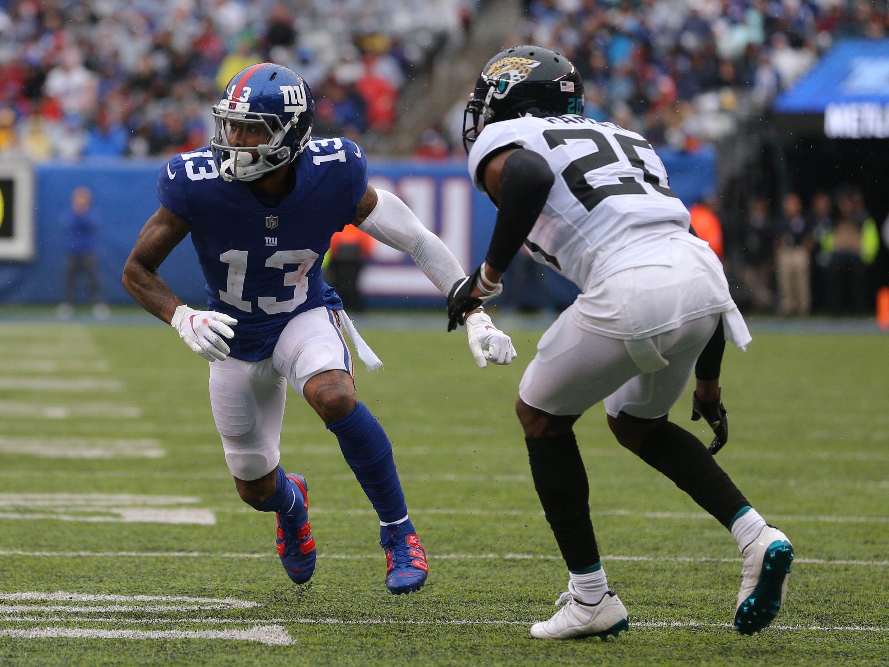 New York Giants wide receiver Odell Beckham Jr. runs a route against Jacksonville Jaguars cornerback Jalen Ramsey during the second quarter at MetLife Stadium.