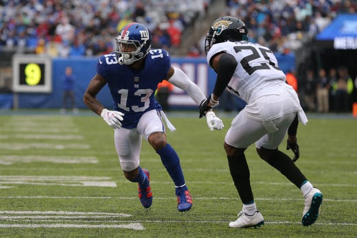 New York Giants wide receiver Odell Beckham Jr. runs a route against Jacksonville Jaguars cornerback Jalen Ramsey during the second quarter at MetLife Stadium. - Packers QB Carted Off In Clash With Bears