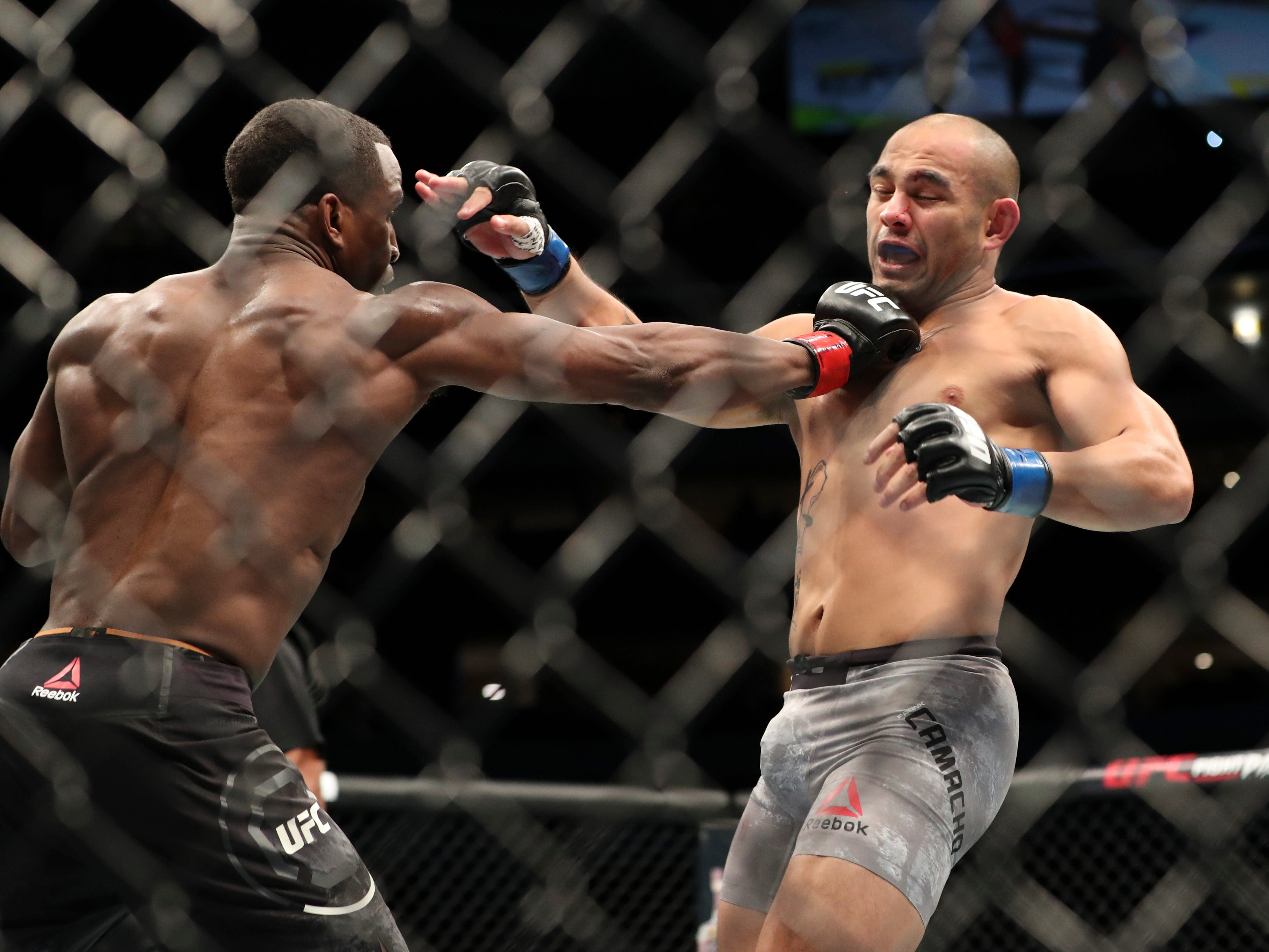 Geoff Neal (red gloves) fights Frank Camacho (blue gloves) during UFC 228 at American Airlines Center.