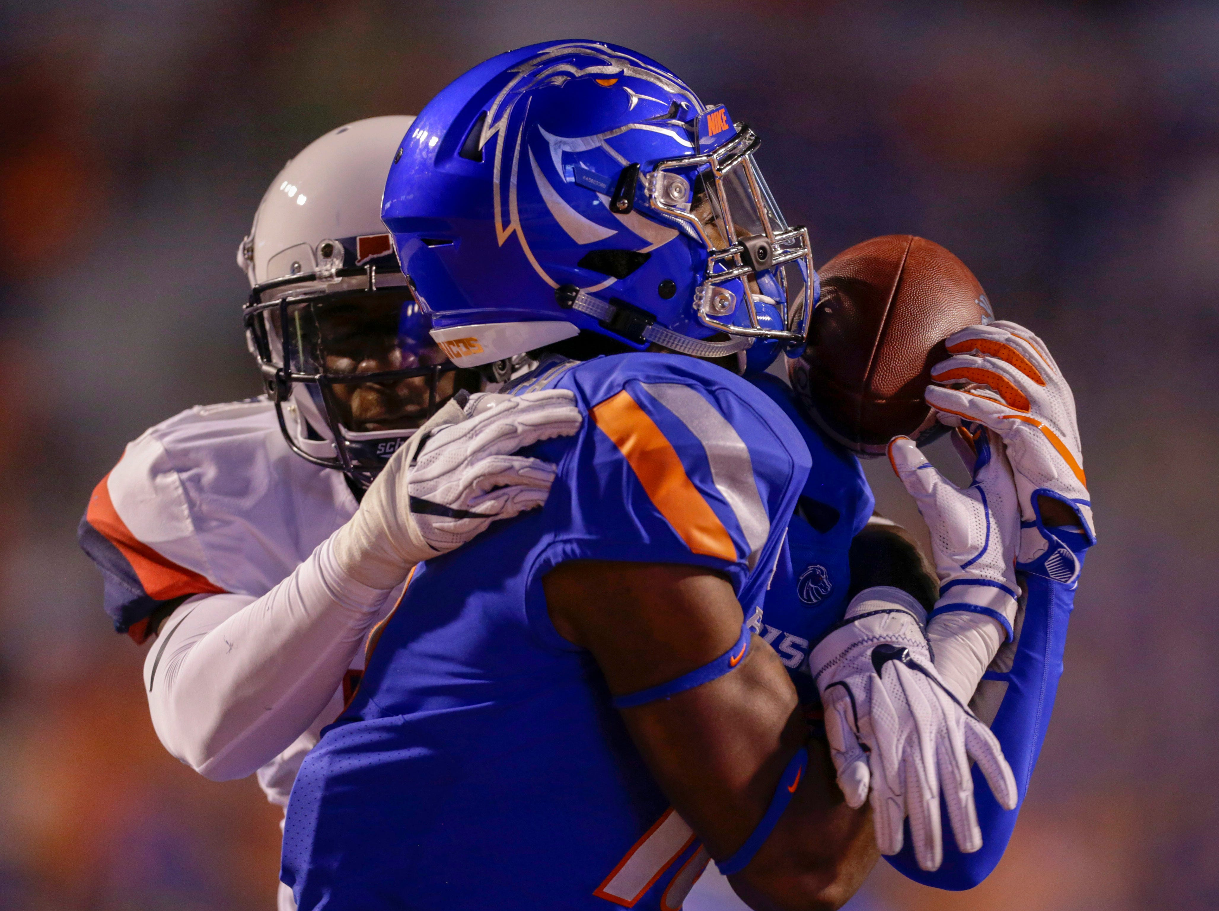 Boise State Broncos wide receiver John Hightower (16) attempts to catch long pass only to have it broken up by Connecticut Huskies safty Omar Fortt (27) during second half action at Albertsons Stadium