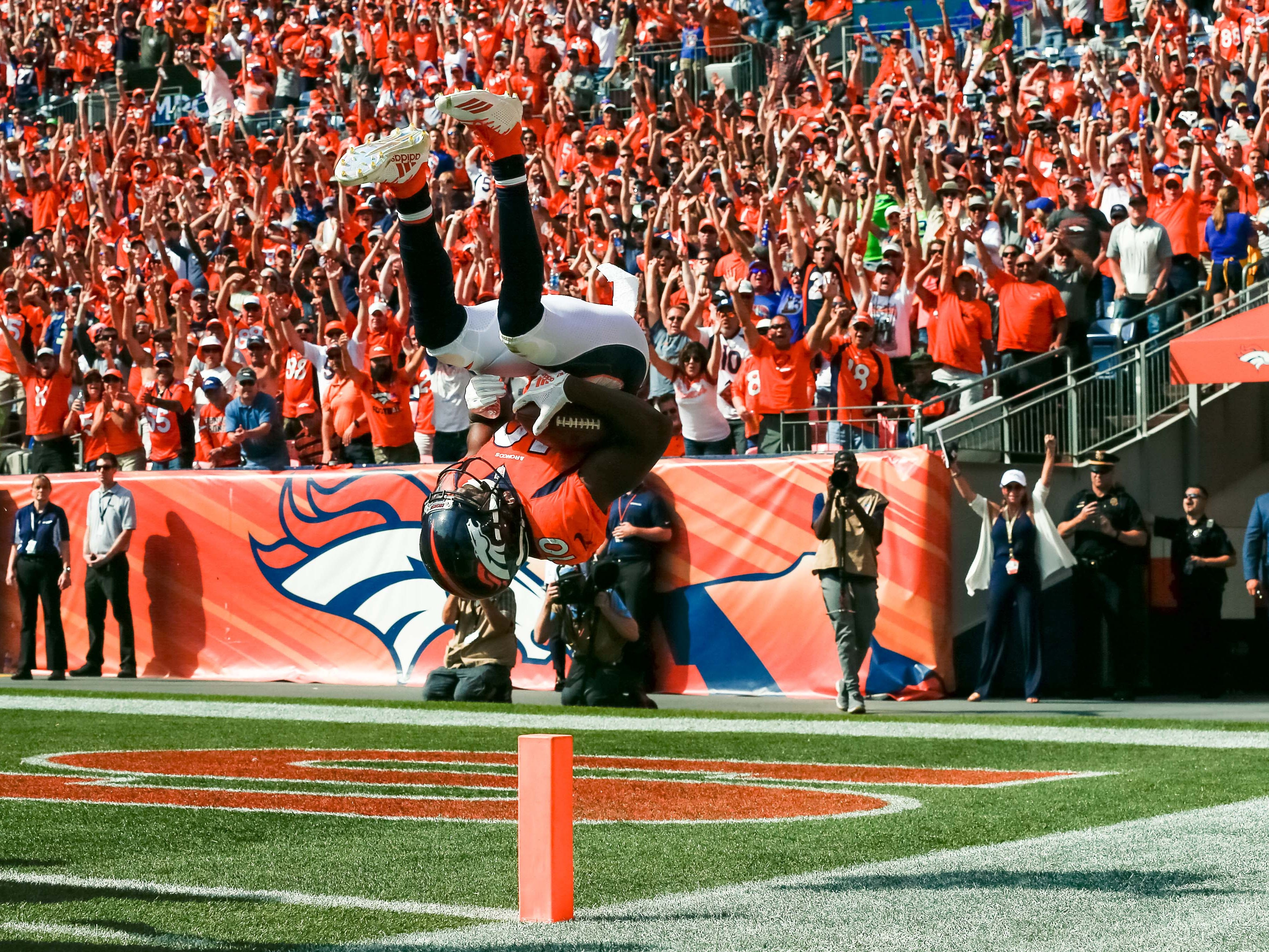 Sep 9, 2018; Denver, CO, USA; Denver Broncos wide receiver Emmanuel Sanders (10) flips into the end zone after scoring a touchdown in the second quarter against the Seattle Seahawks at Broncos Stadium at Mile High. Mandatory Credit: Isaiah J. Downing-USA TODAY Sports