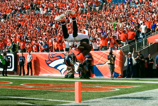 Sep 9, 2018; Denver, CO, USA; Denver Broncos wide receiver Emmanuel Sanders (10) flips into the end zone after scoring a touchdown in the second quarter against the Seattle Seahawks at Broncos Stadium at Mile High. Mandatory Credit: Isaiah J. Downing-USA TODAY Sports - Packers QB Carted Off In Clash With Bears