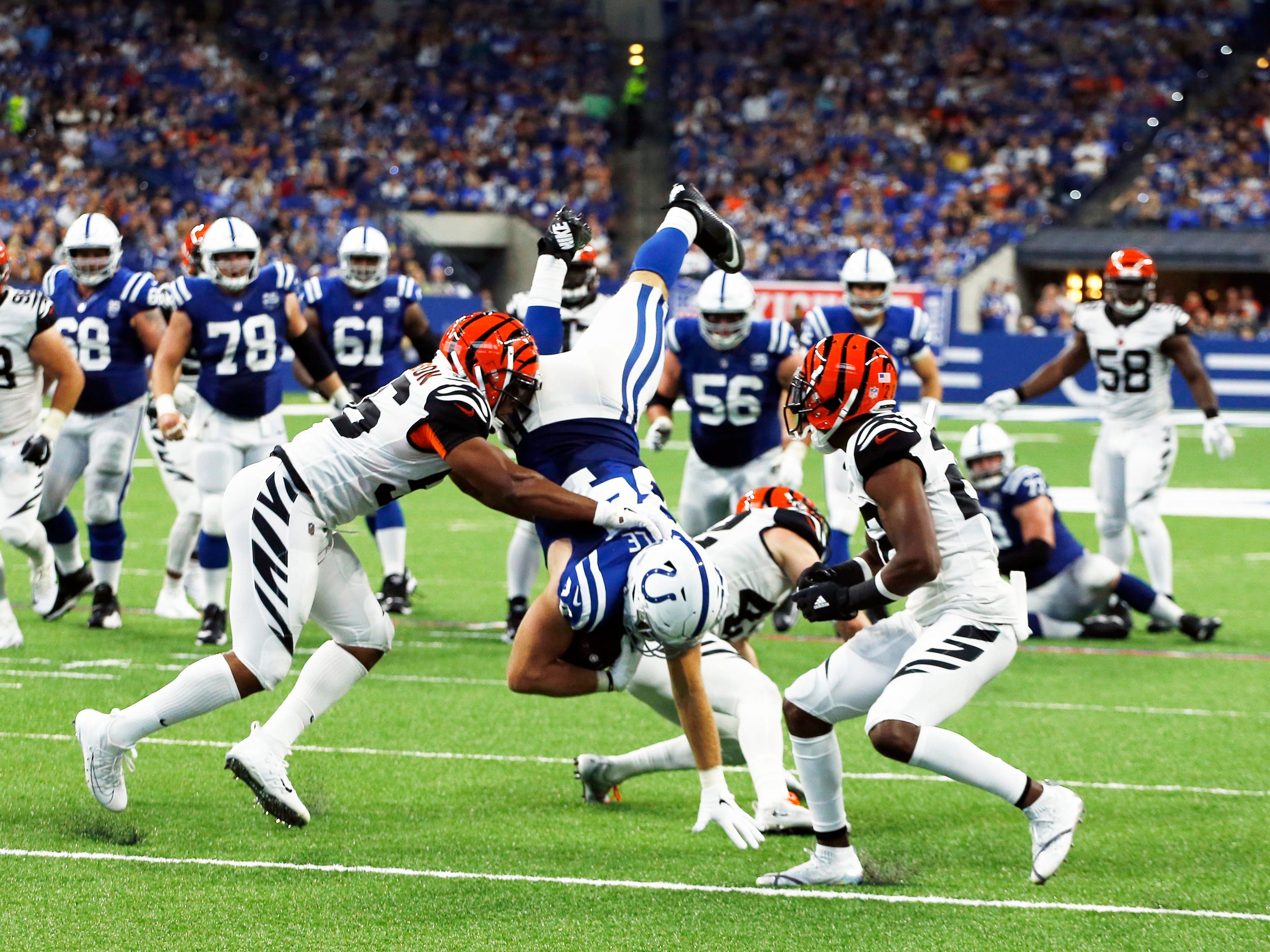 Sep 9, 2018; Indianapolis, IN, USA; Indianapolis Colts tight end Jack Doyle (84) gets upended by Cincinnati Bengals safety Clayton Fejedelem (42) during the 3rd quarter at Lucas Oil Stadium. Mandatory Credit: Brian Spurlock-USA TODAY Sports