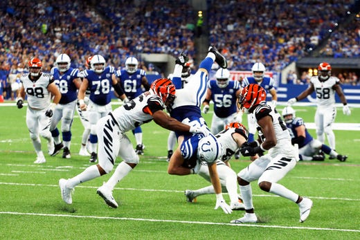 Sep 9, 2018; Indianapolis, IN, USA; Indianapolis Colts tight end Jack Doyle (84) gets upended by Cincinnati Bengals safety Clayton Fejedelem (42) during the 3rd quarter at Lucas Oil Stadium. Mandatory Credit: Brian Spurlock-USA TODAY Sports - Packers QB Carted Off In Clash With Bears