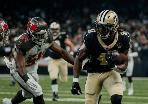 New Orleans Saints running back Alvin Kamara (runs past Tampa Bay Buccaneers linebacker Lavonte David during the first quarter of a game at the Mercedes-Benz Superdome. - Packers QB Carted Off In Clash With Bears