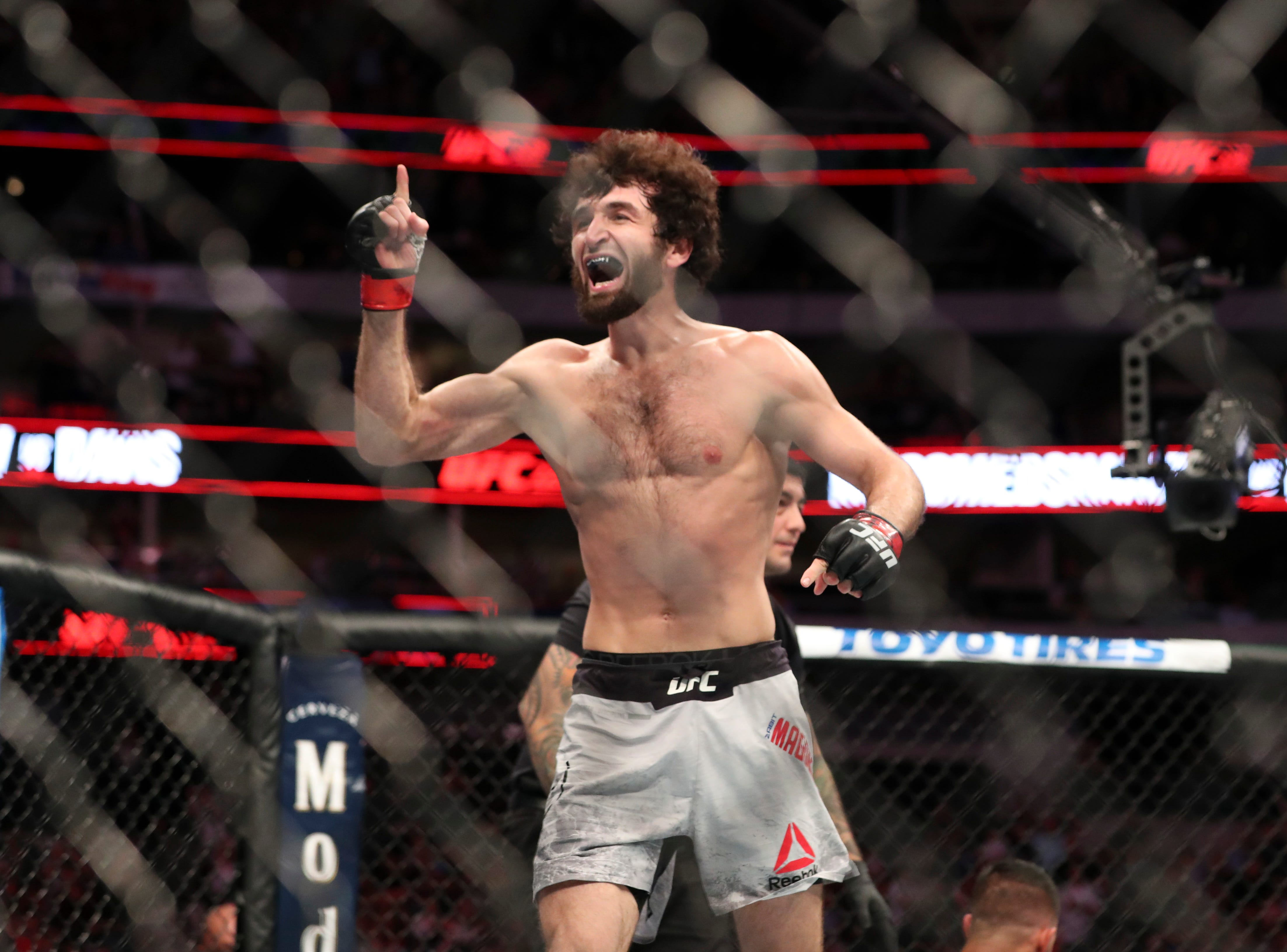 Zabit Magomedsharipov (red gloves) reacts after defeating  Brandon Davis (not pictured) during UFC 228 at American Airlines Center.