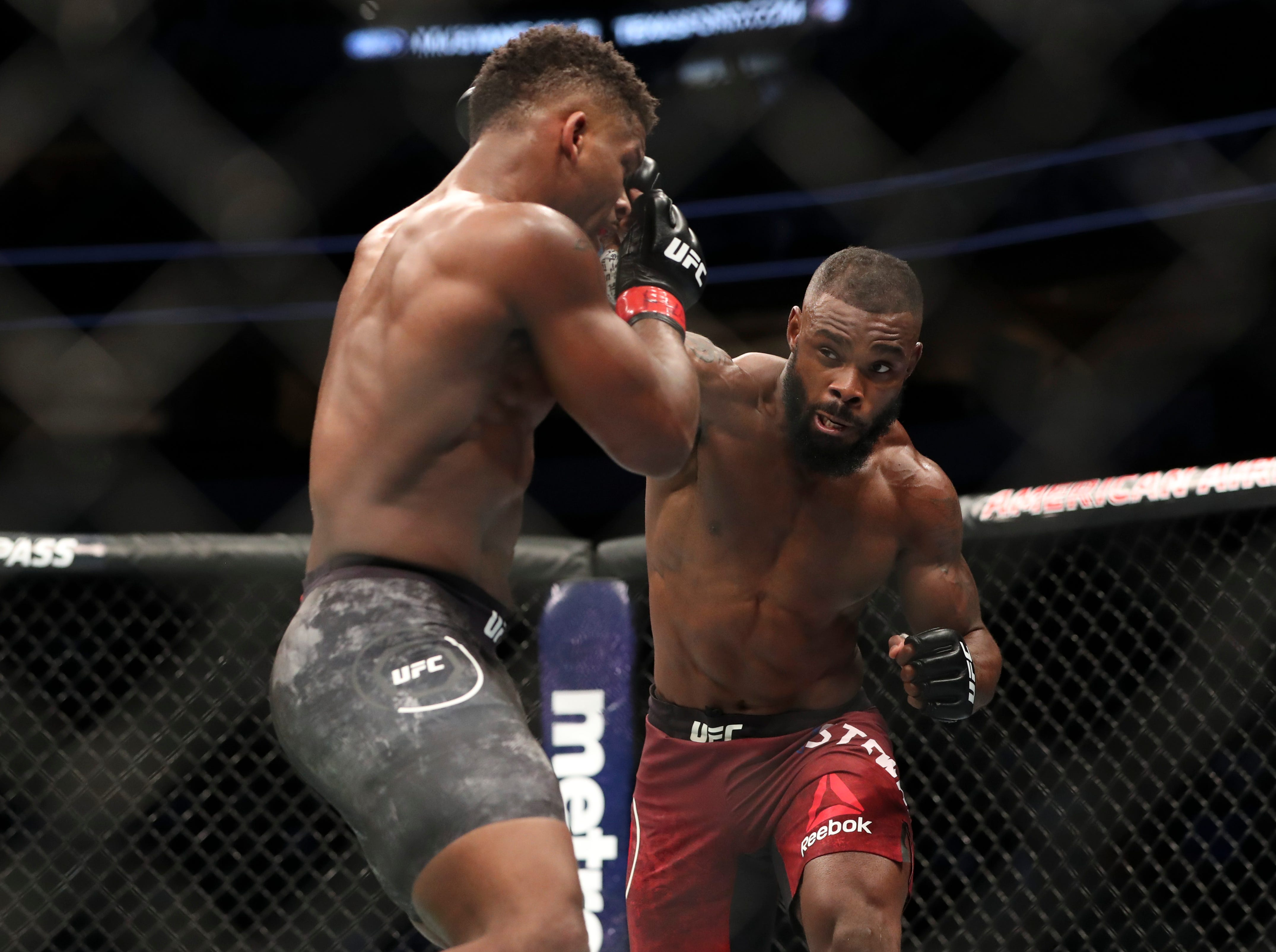 Charles Byrd (red gloves) fights Darren Stewart (blue gloves) during UFC 228 at American Airlines Center.